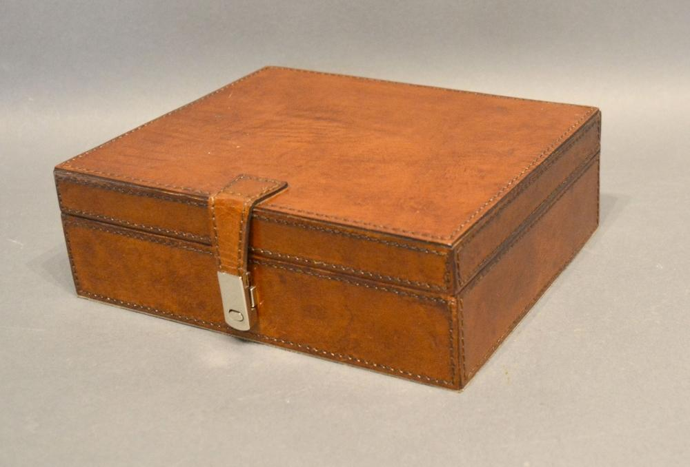 Lot 307 - A Leather Jewellery Box, the hinged cover enclosing a fitted interior