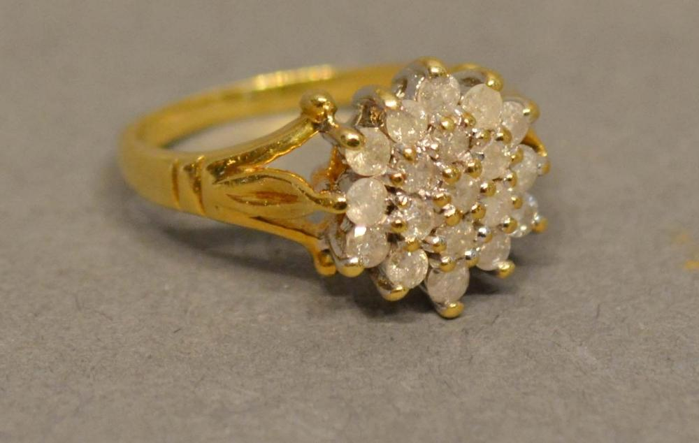 Lot 198 - An 18 Carat Yellow Gold Diamond Cluster Ring set with many diamonds within a pierced setting
