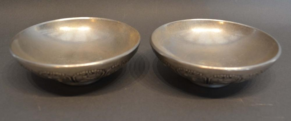 Lot 278 - A Pair of Chinese White Metal Dishes decorated in relief with reserves depicting animals, seal marks