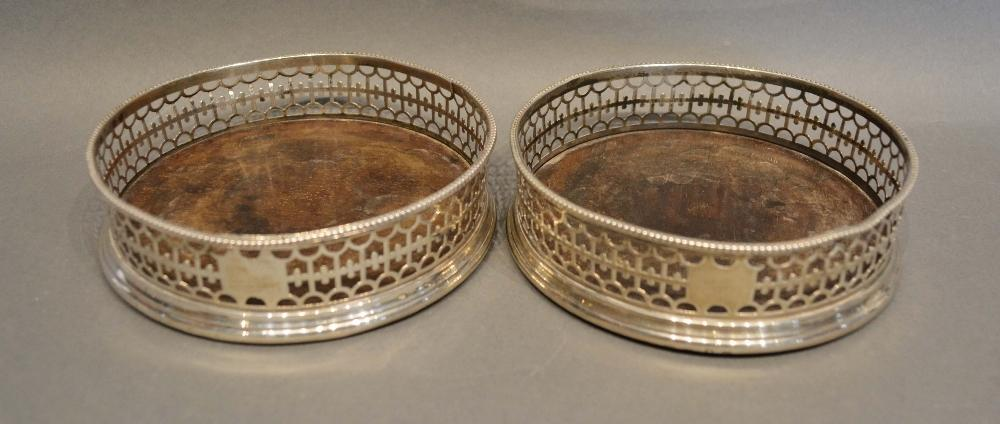 Lot 192 - A Pair of George III Silver Bottle Coasters of pierced galleried form (marks rubbed)