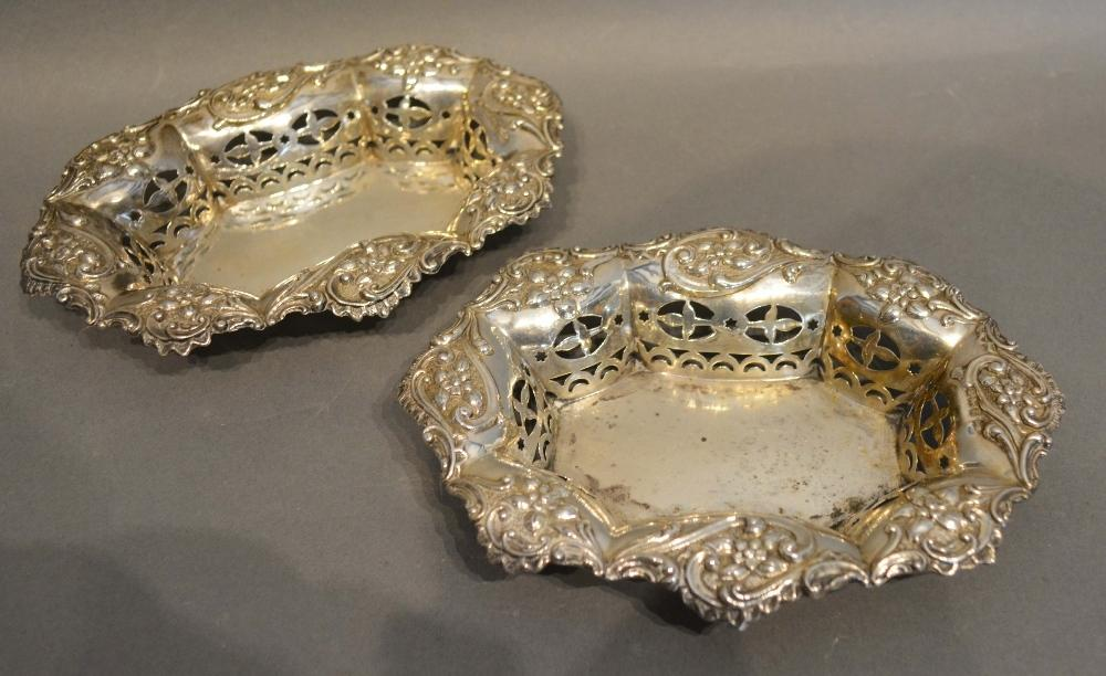 Lot 191 - A Pair of Sheffield Silver Pierced and Embossed Decorated Bonbon Dishes of oval shaped form,