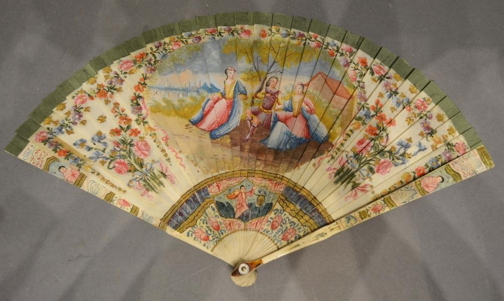 Lot 317 - An Early 18th Century Ivory Fan of French or Flemish origin, painted both sides with cartouches