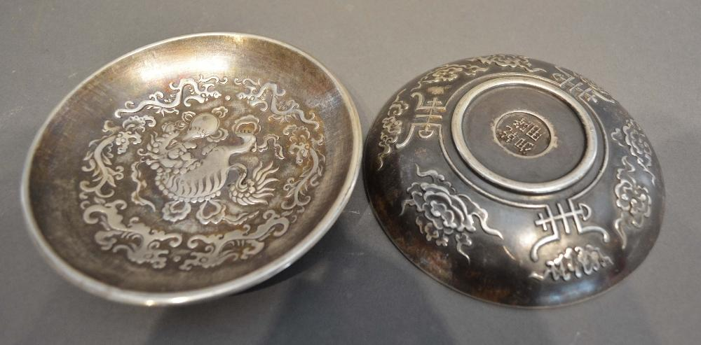 Lot 281 - A Pair of Chinese White Metal Bowls decorated in relief with serpents amongst foliage, seal marks to