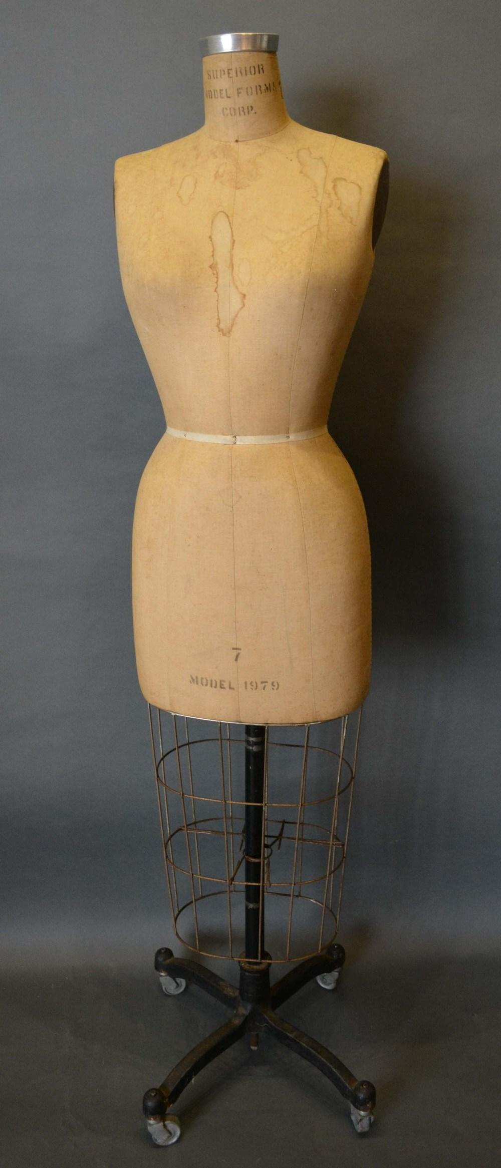 Lot 298 - An Early Tailors Dummy by the Superior Model Forms Corporation and with wrought iron stand, 145cm