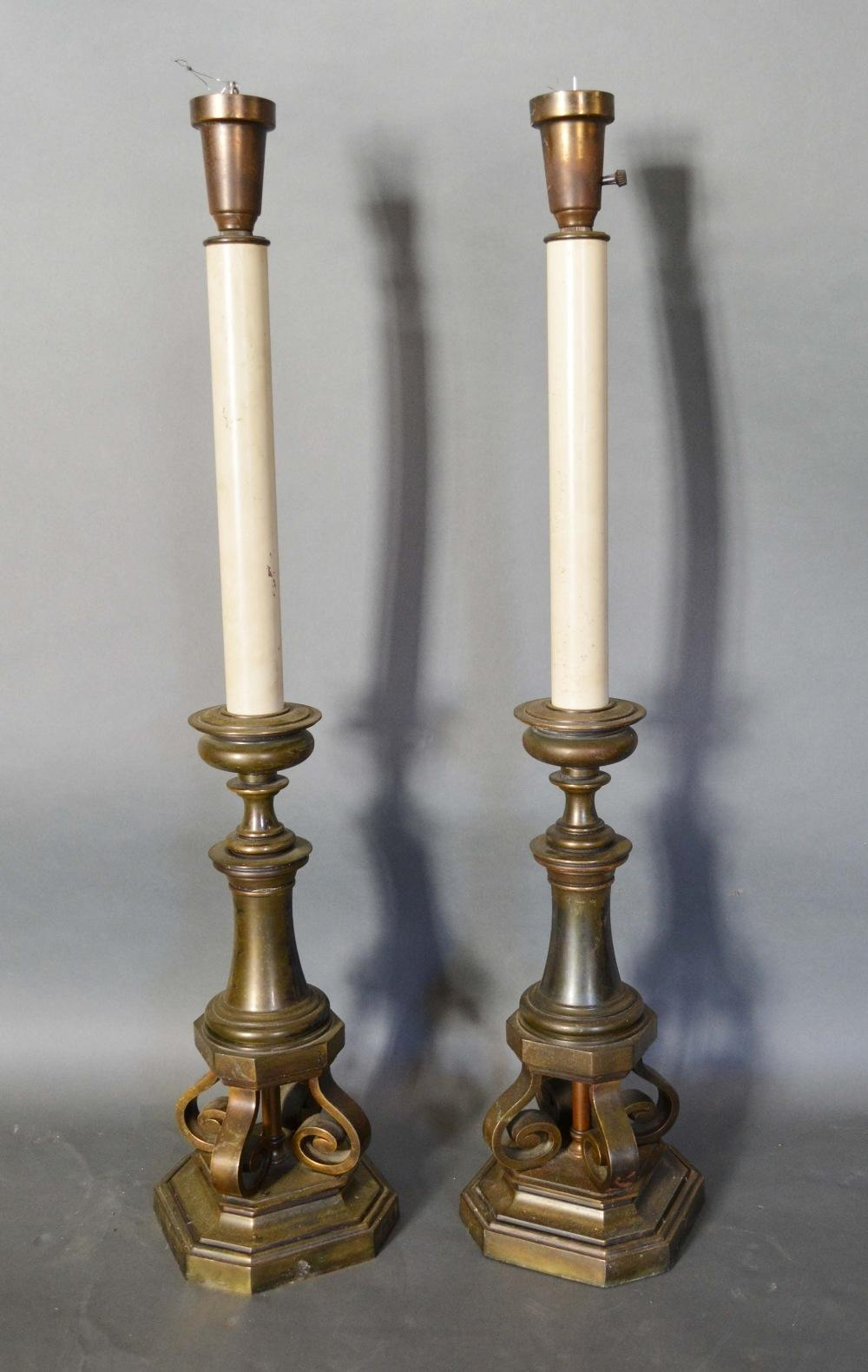 Lot 300 - A Pair of 18th Century Style Table Lamps in the form of candle stands, each with four scroll feet