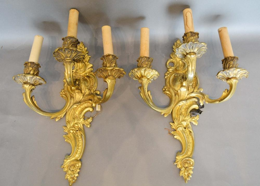 Lot 266 - A Pair of French Ormolu Three Branch Wall Sconces of shaped scroll form, 44cm long