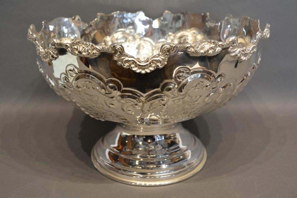 Lot 203 - A Silver Plated Large Punch Bowl embossed with scrolls and foliage upon a circular pedestal base,