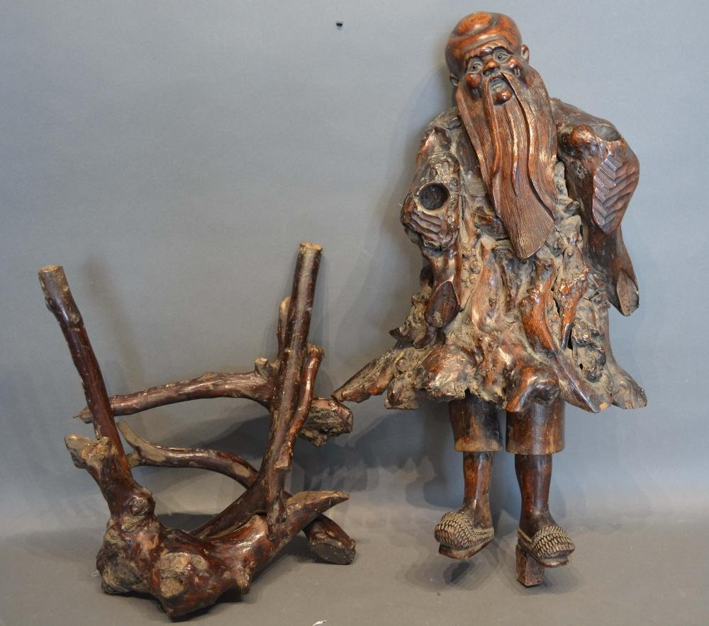 Lot 294 - An Early Chinese Root Carving in the form of a figure, 56cm tall