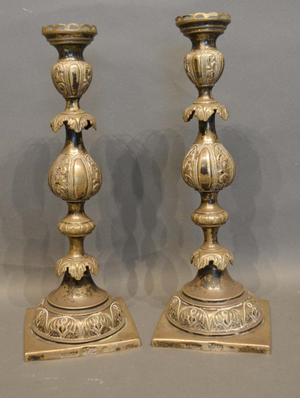 Lot 187 - A Pair of Russian Silver Candlesticks by JA Goldman, St Petersburg, 1874, with floral engraved