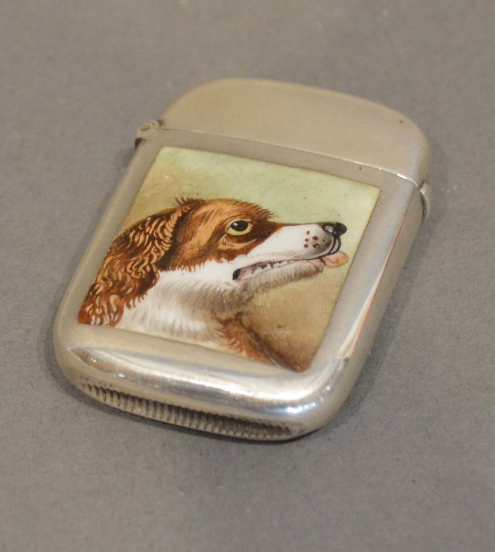 Lot 189 - A Victorian Birmingham Silver Vesta Case, the front with enamel panel, decorated with a dog's head