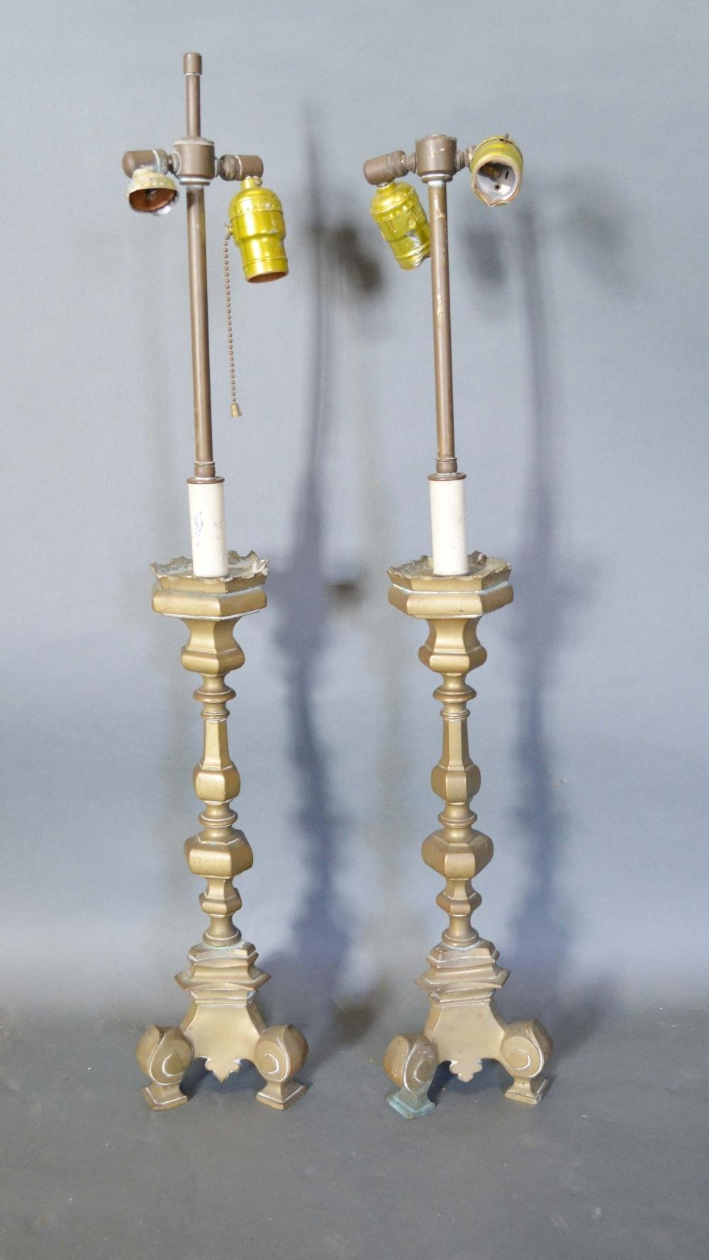 Lot 299 - A Pair of 18th Century Style Brass Table Lamps of shaped octagonal form with triform scroll feet,