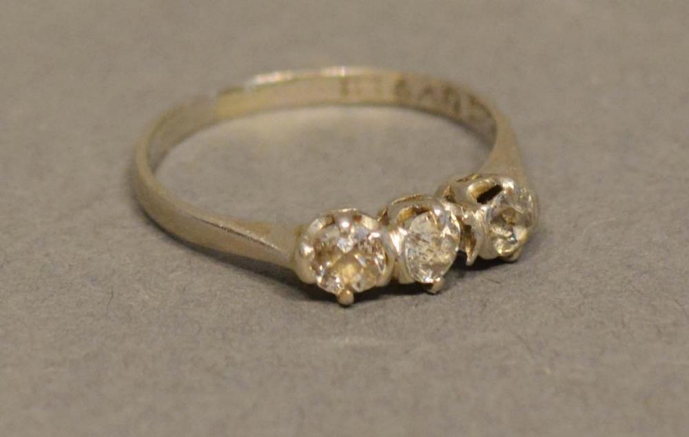 Lot 197 - An 18 Carat White Gold Three Stone Diamond Ring set with three oval diamonds within a pierced