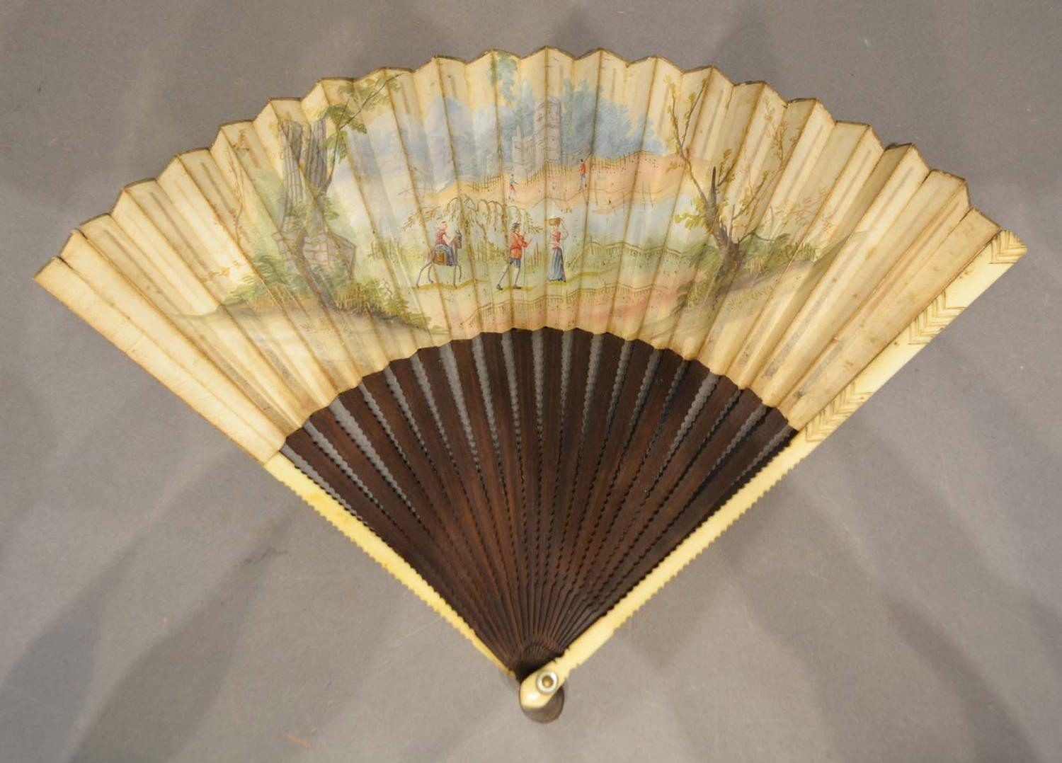 Lot 324 - An Early 18th Century German Fan, hand painted with figures within a landscape with shaped wooden