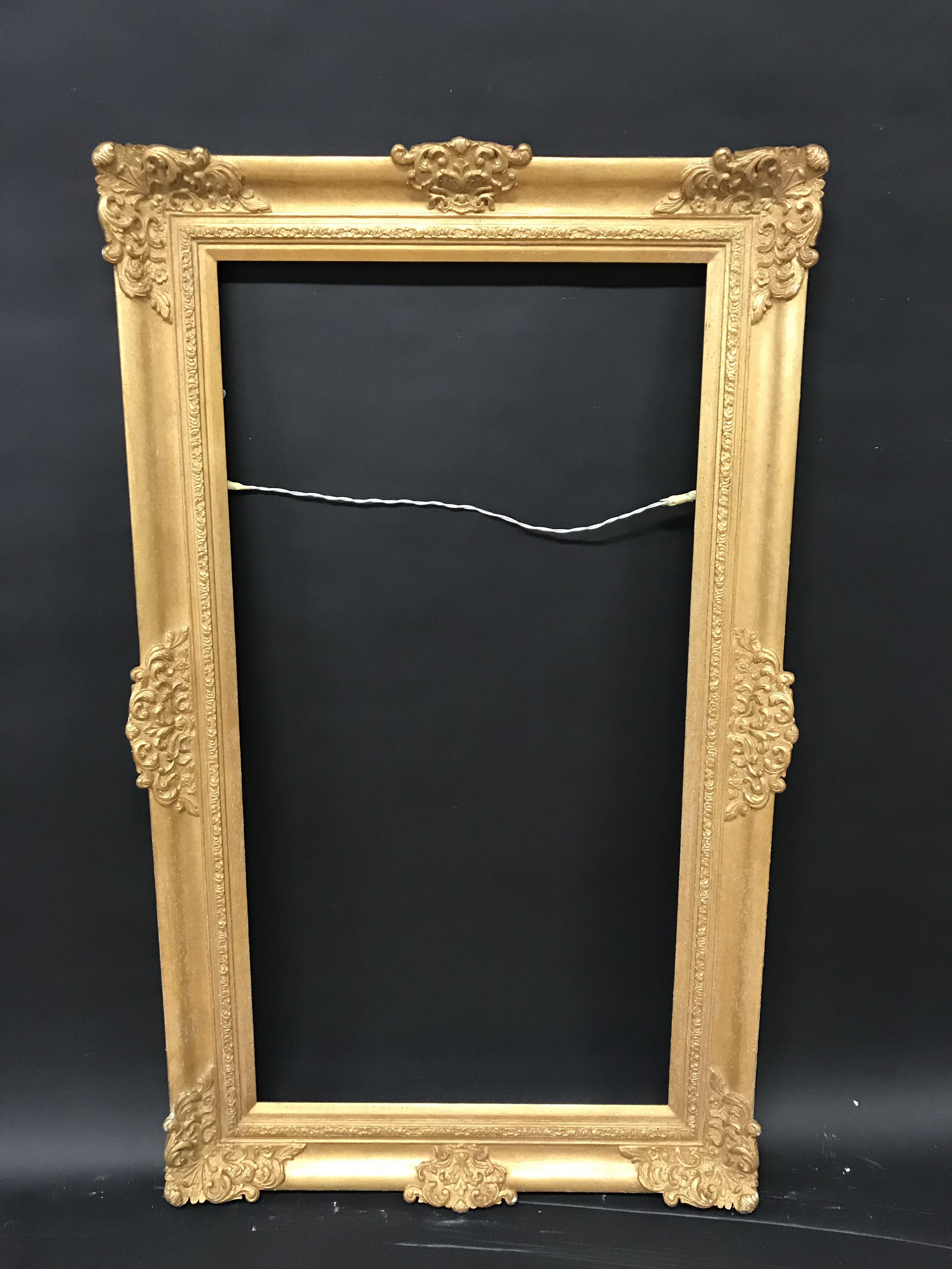 "Lot 13 - 20th Century English School. A Gilt Frame with Swept Centres and Corners, 42"" x 22"" (rebate)."