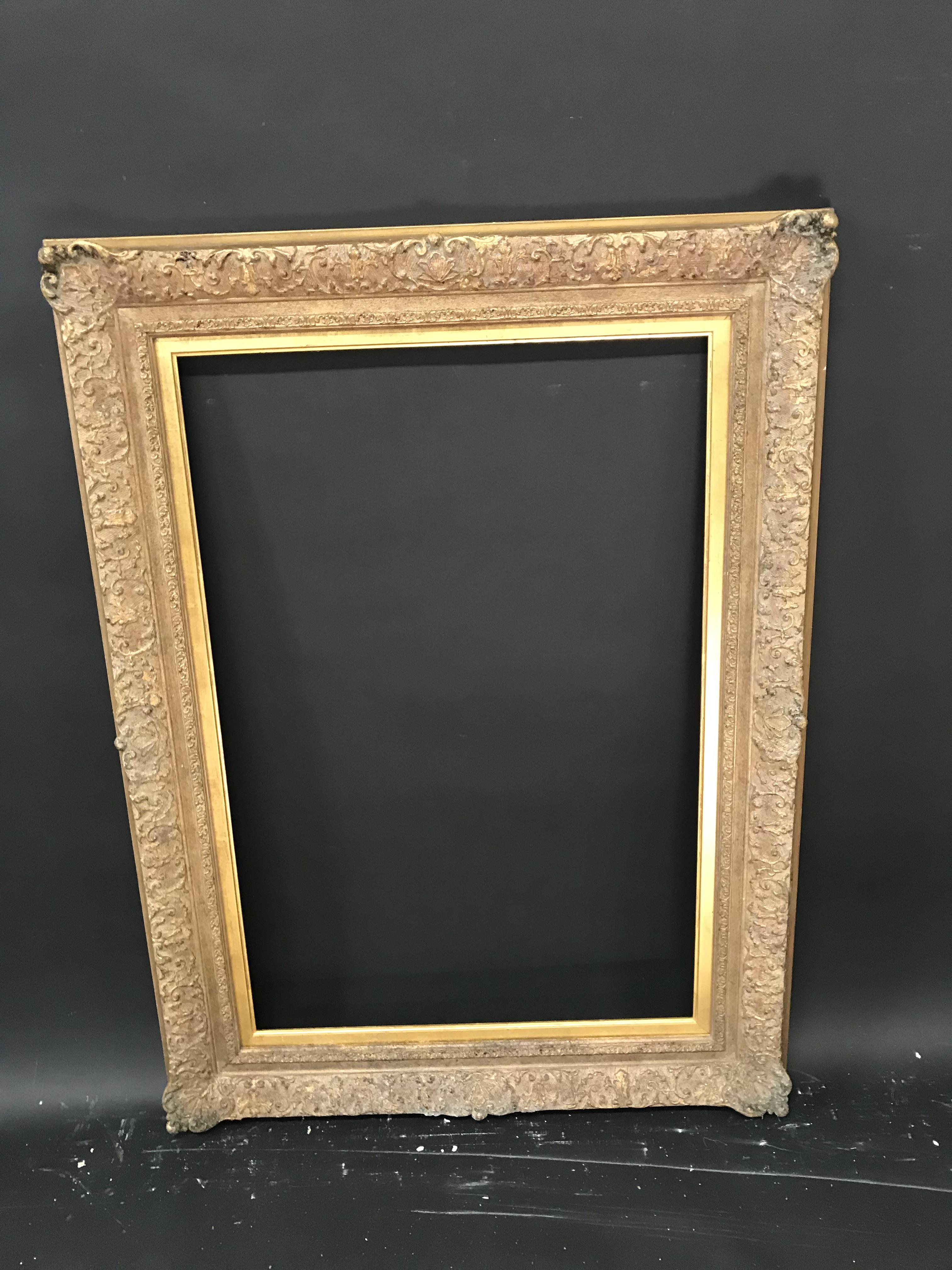 "Lot 40 - 20th Century English School. A Gilt Composition Frame, with Swept Centres and Corners, 31.25"" x"