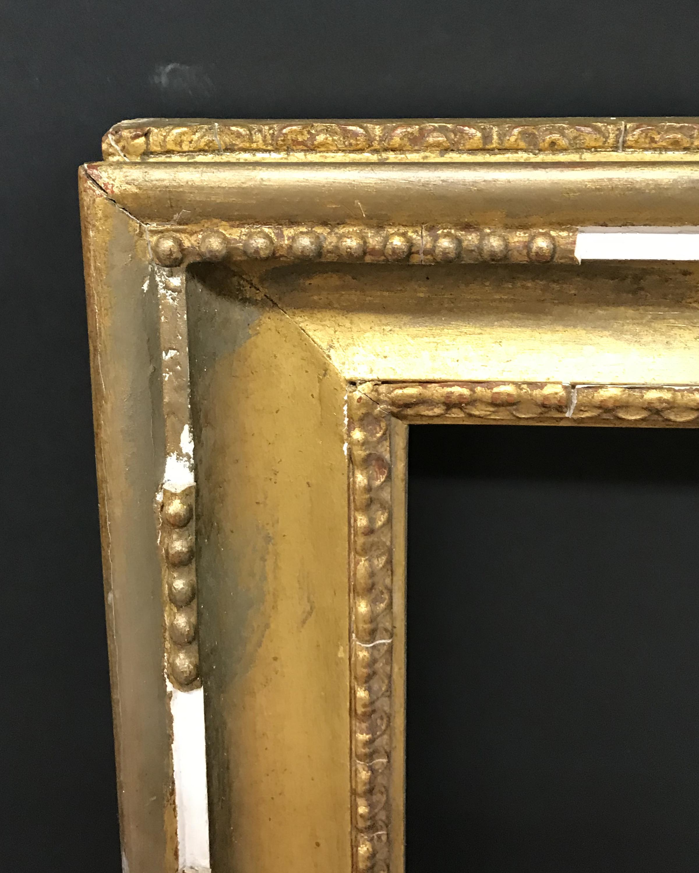 "Lot 23 - 20th Century English School. A Gilt Composition Hollowed Frame, 30"" x 20"" (rebate)."