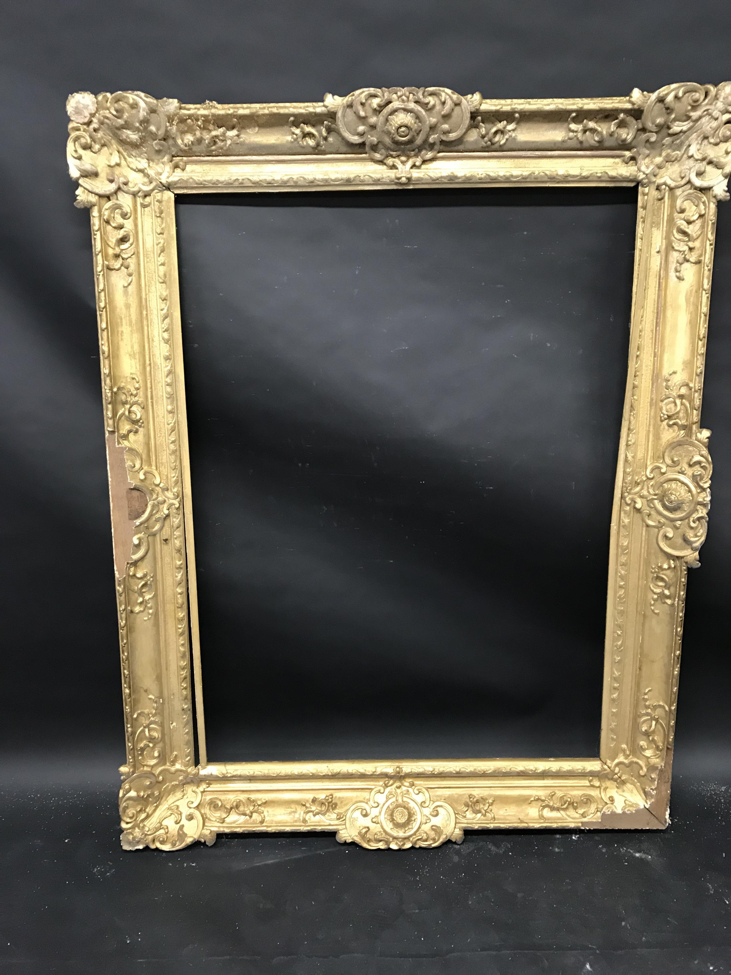 Lot 48 - Early 18th Century French School. A Louis XIV Carved Giltwood Oak Frame with swept centres and