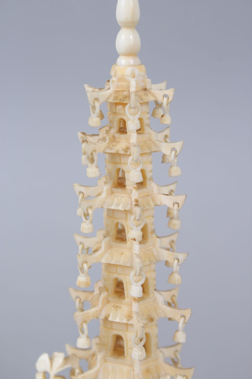 Lot 42 - A GOOD 19TH CENTURY CHINESE CARVBED IVORY PAGODA FIGURE, on its hardwood base, 20cm high overall x