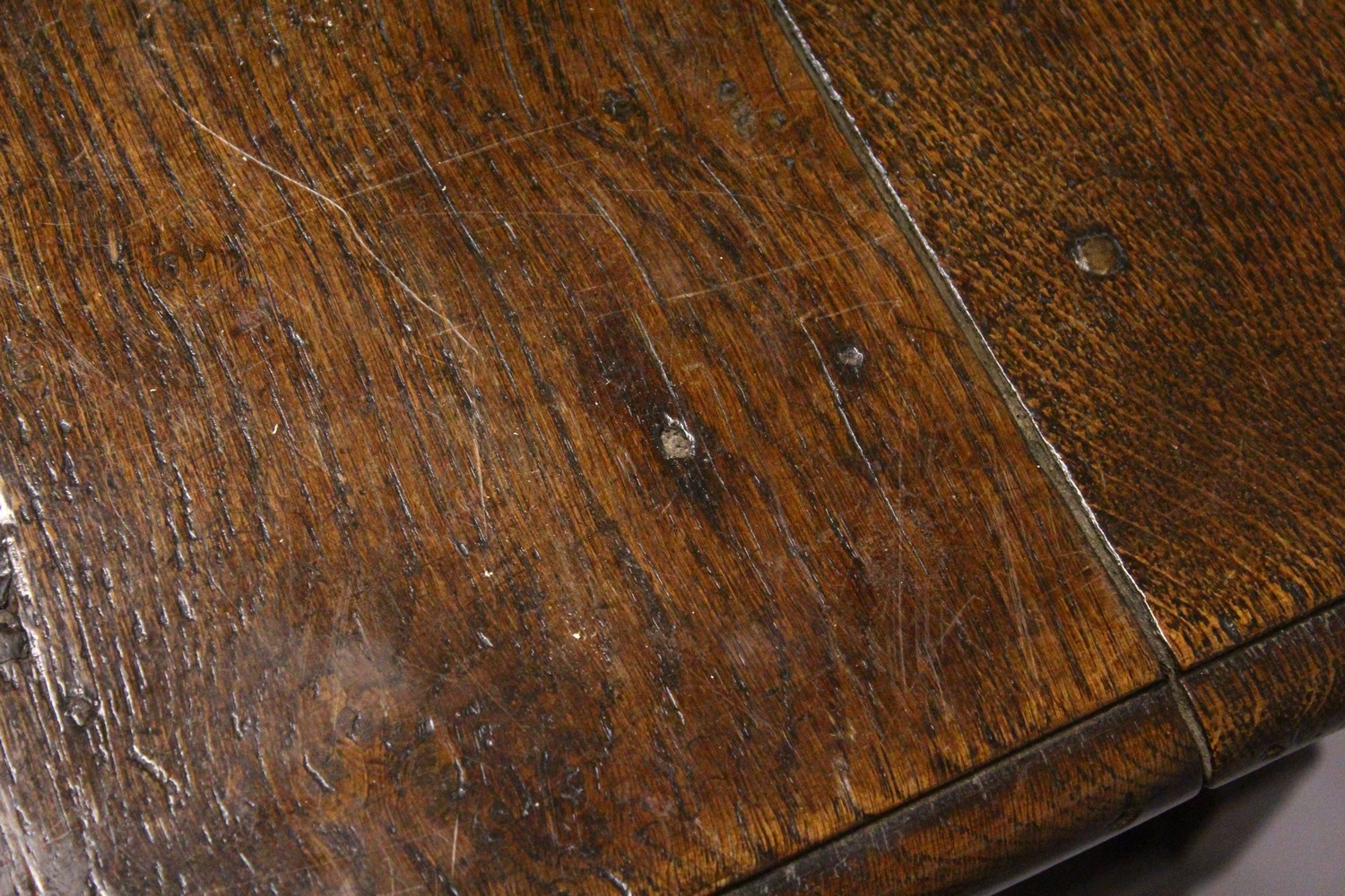 Lot 1014 - AN 18TH CENTURY OAK SIDE TABLE, with plain three plank top, single frieze drawer with brass handles,