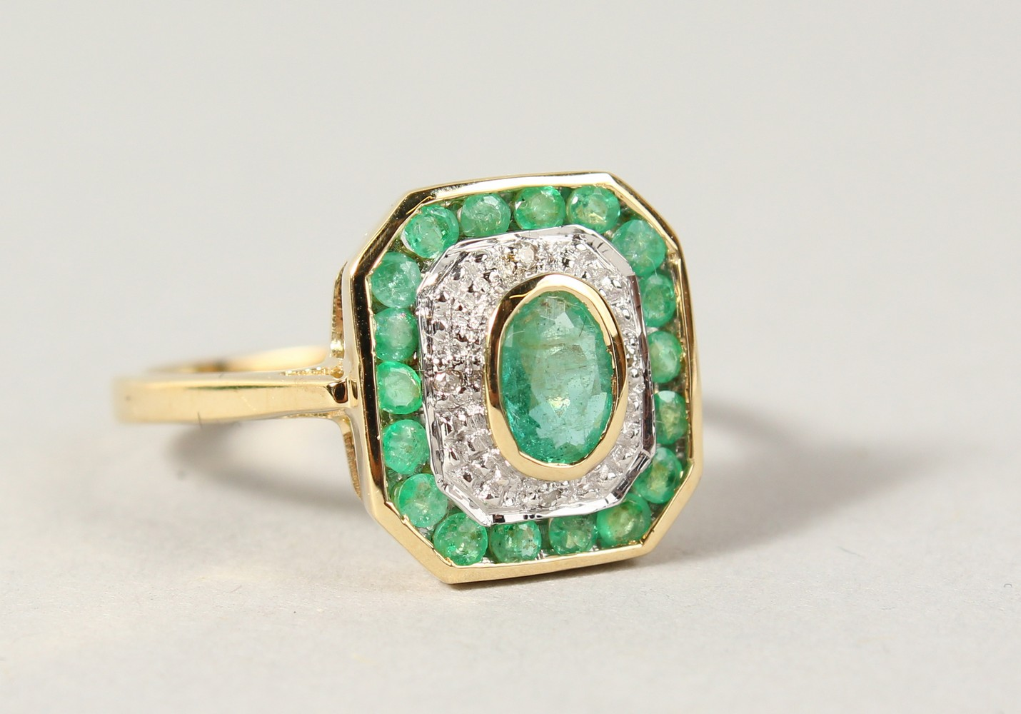 Lot 1766 - A 9CT GOLD, EMERALD AND DIAMOND ART DECO STYLE RING.