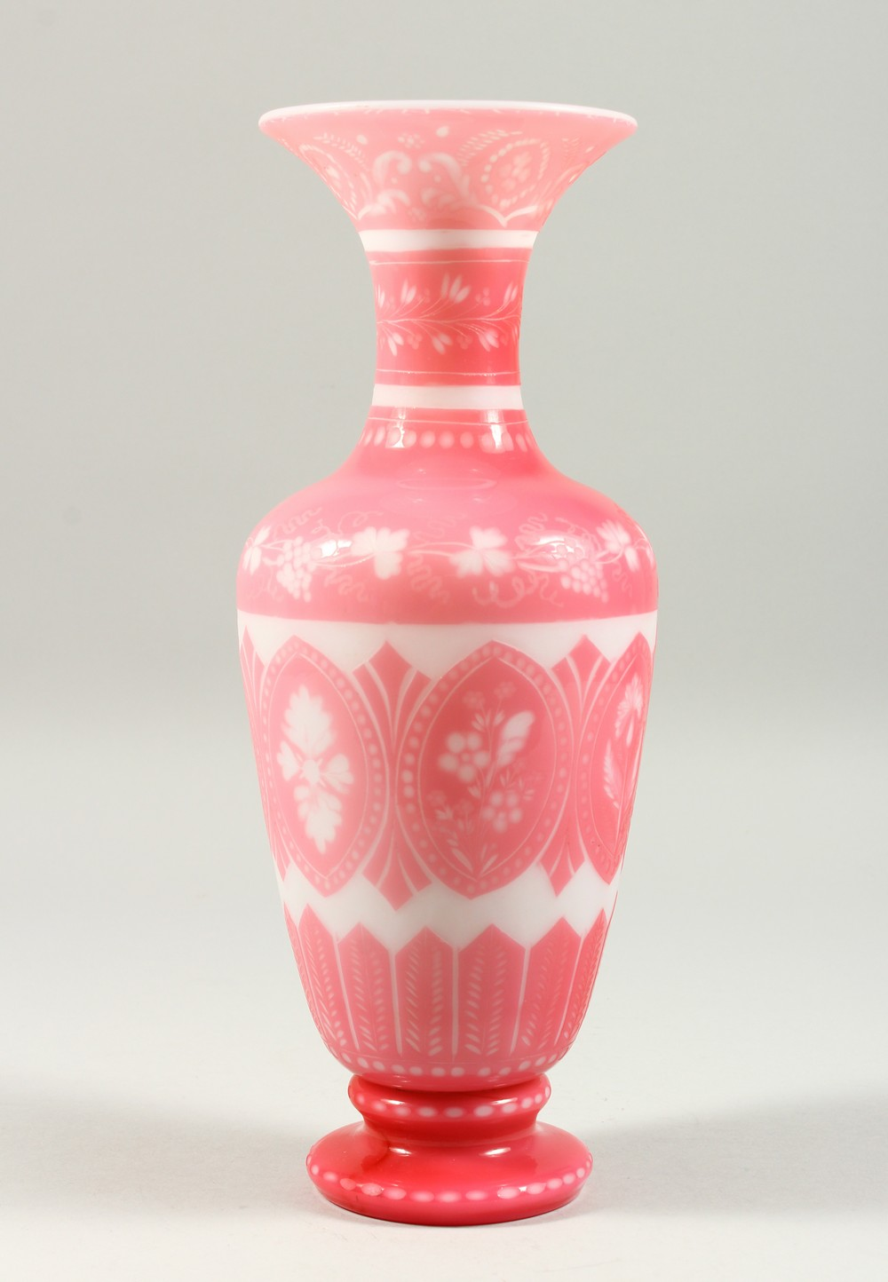 "Lot 1044 - A PINK ""DOLCE RELIVO"" OPAQUE GLASS BALUSTER SHAPED VASE, with incised floral & grape and vine"