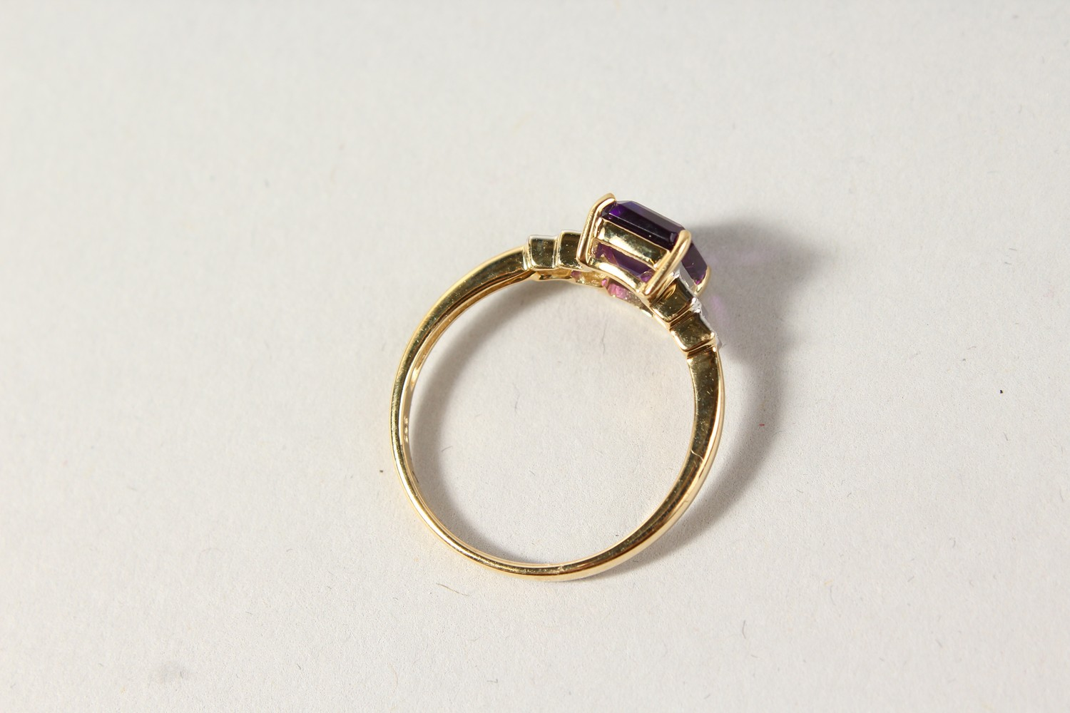 Lot 1763 - A 9CT GOLD EMERALD CUT AMETHYST AND DIAMOND RING.