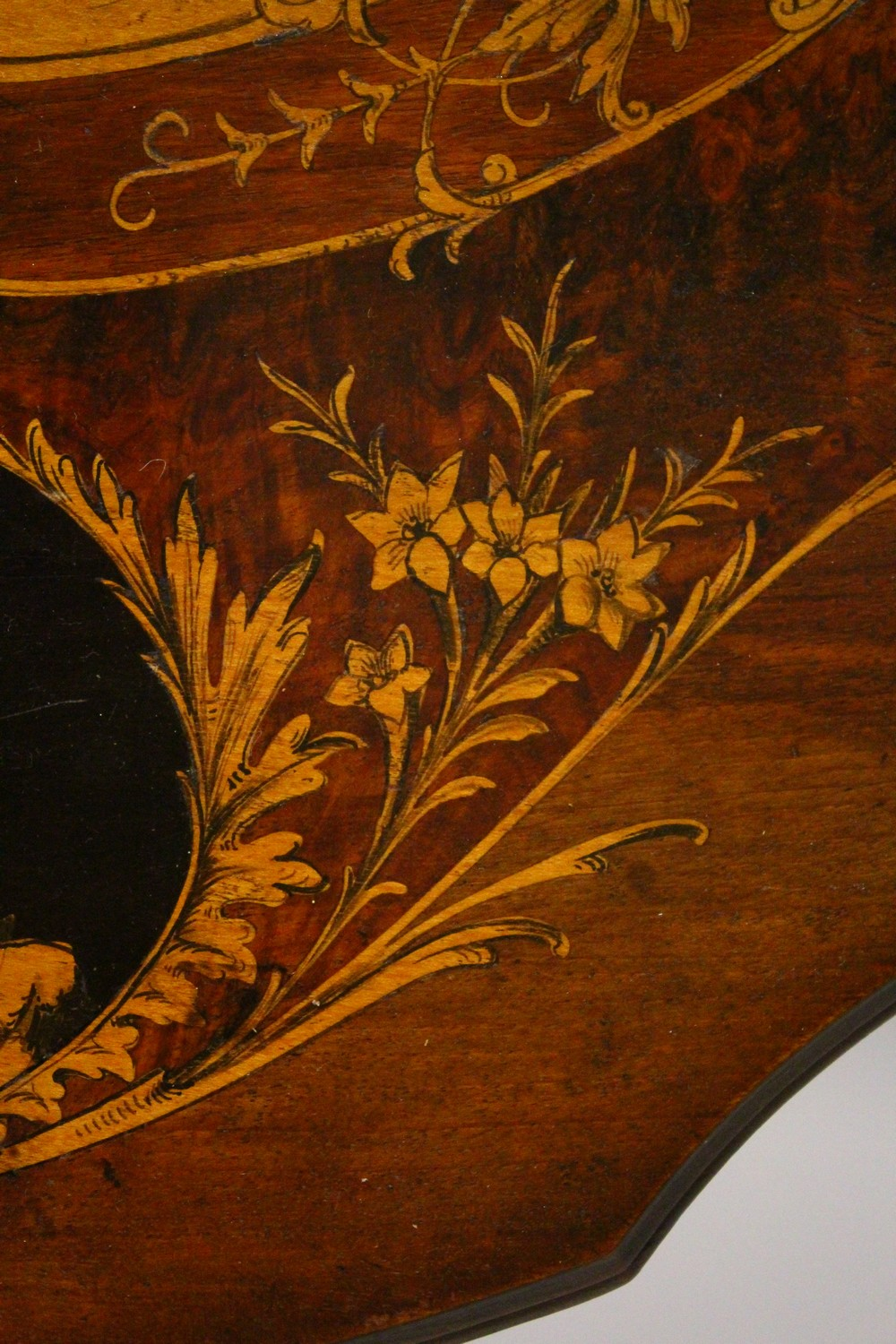 Lot 1001 - A LATE 19TH CENTURY BLACK FOREST INLAID WALNUT TRIPOD TABLE, the shaped top inlaid with mountain