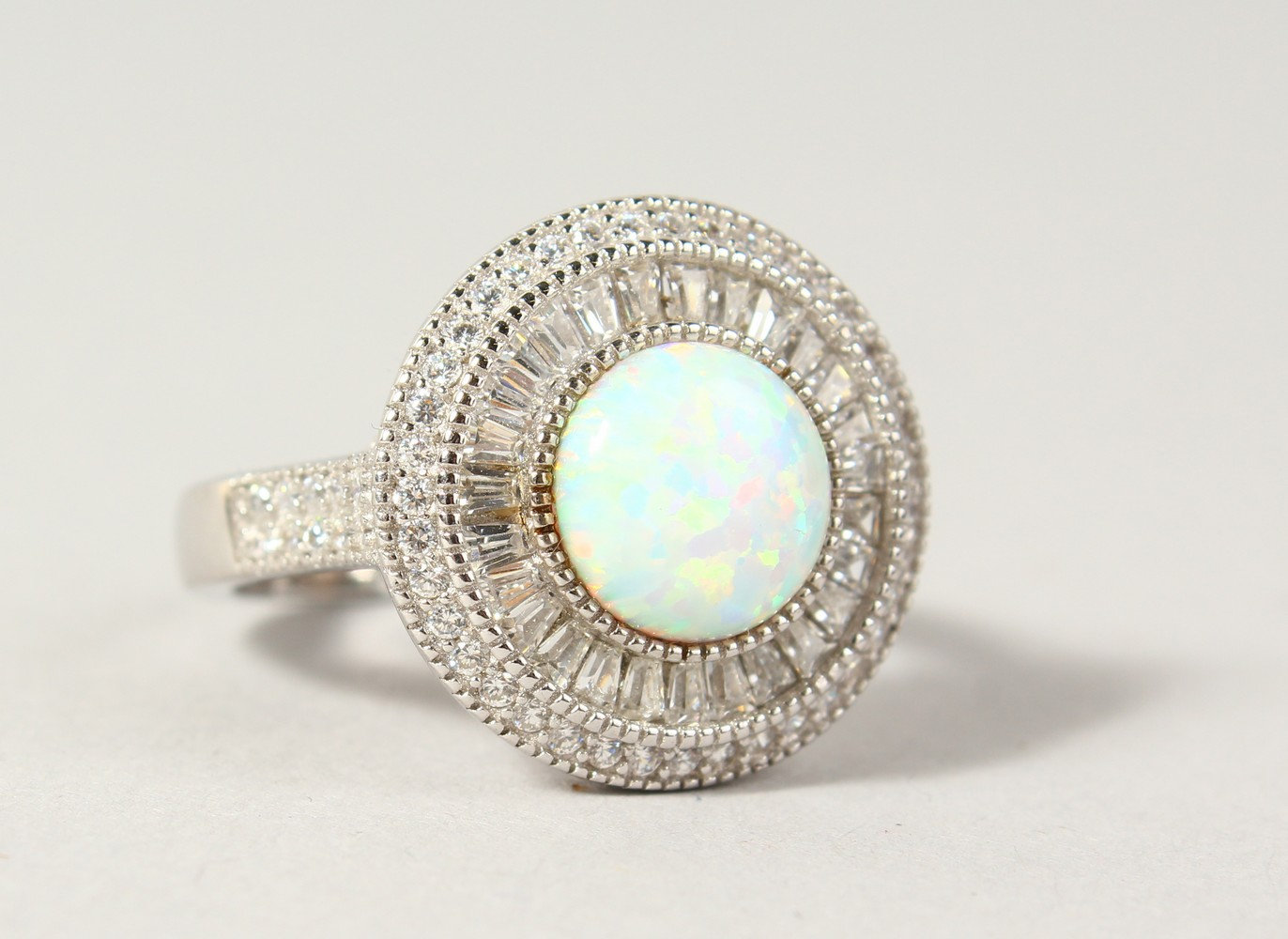 Lot 1776 - A GILSON OPAL AND CZ ROUND SET RING.