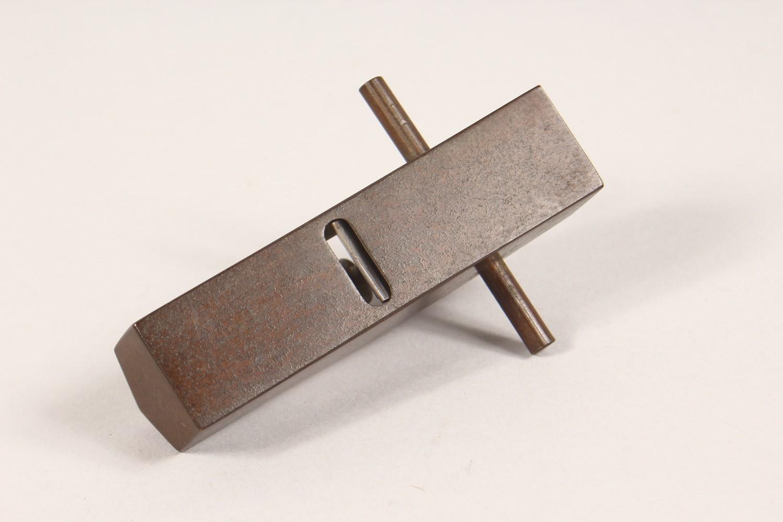 Lot 1709 - A SMALL BRONZE MODEL, of a carpenters plane. 3.25ins long.