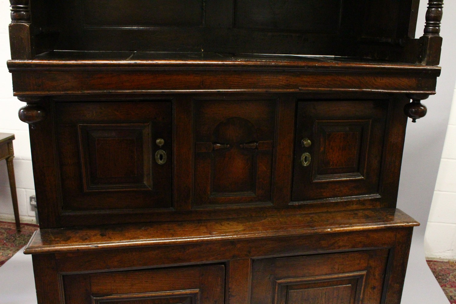 Lot 1010 - A GOOD 18TH CENTURY OAK TRIDARN, the upper section having a moulded cornice, panelled sides and
