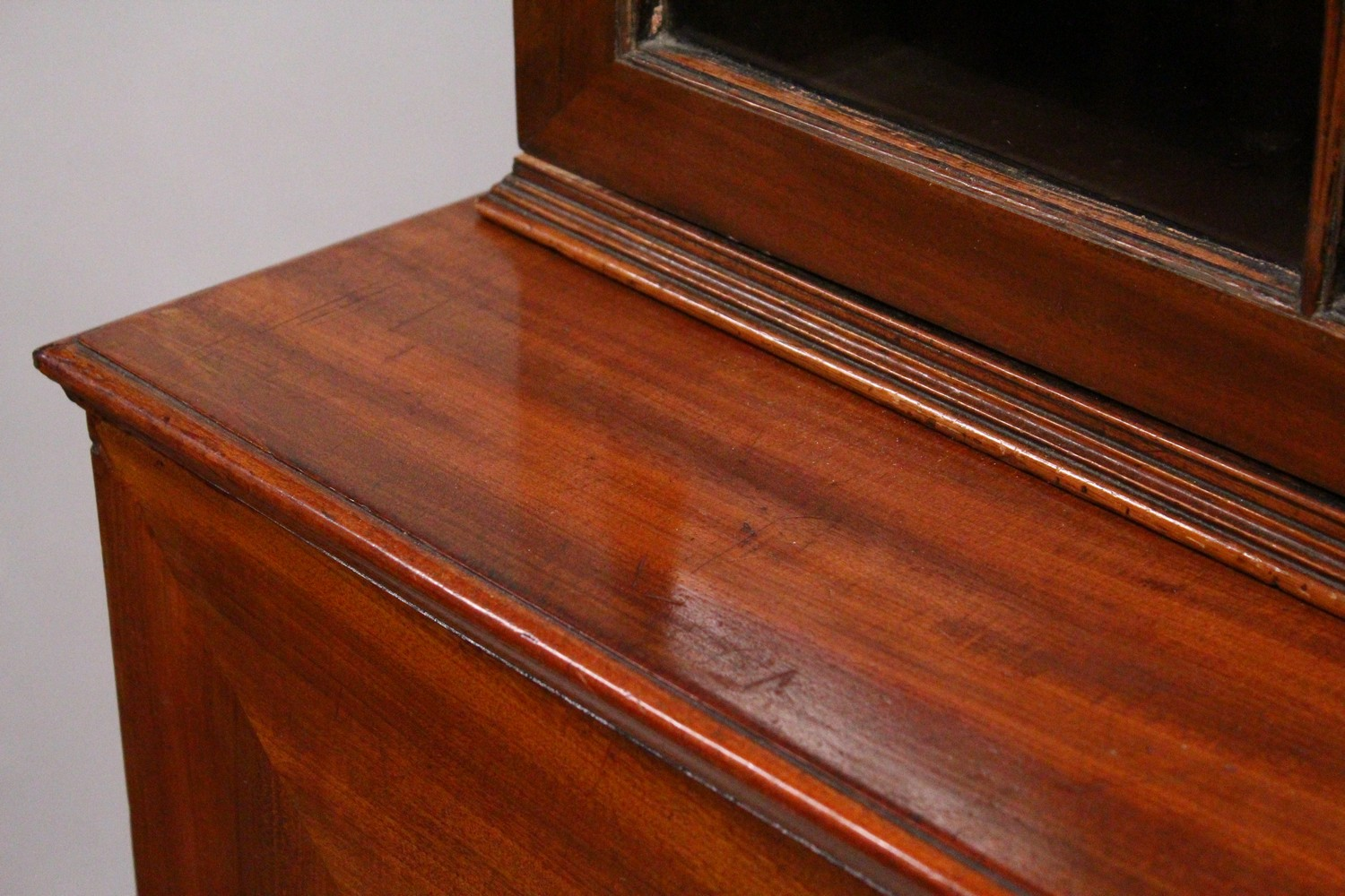 Lot 1027 - A GEORGE III DESIGN MAHOGANY CUPBOARD BOOKCASE, 19TH CENTURY, with a moulded cornice, pair of