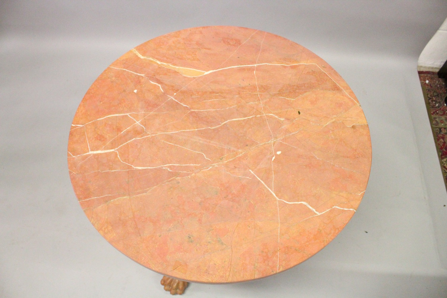 Lot 1022 - A CLASSICAL STYLE PINK VARIEGATED MARBLE CIRCULAR TRIPOD TABLE, with a carved baluster column, three