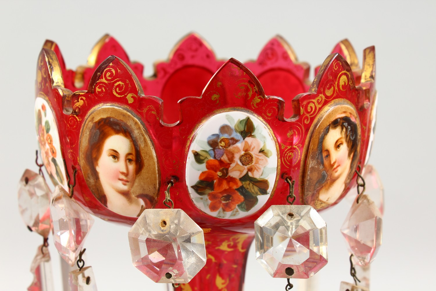 Lot 1058 - A PAIR OF CRANBERRY GLASS TABLE LUSTRES, painted with panels of flowers and female portrait busts.