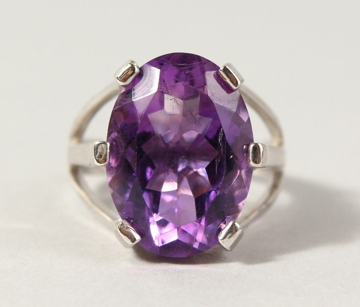 Lot 1769 - A SILVER LARGE AMETHYST SET RING.