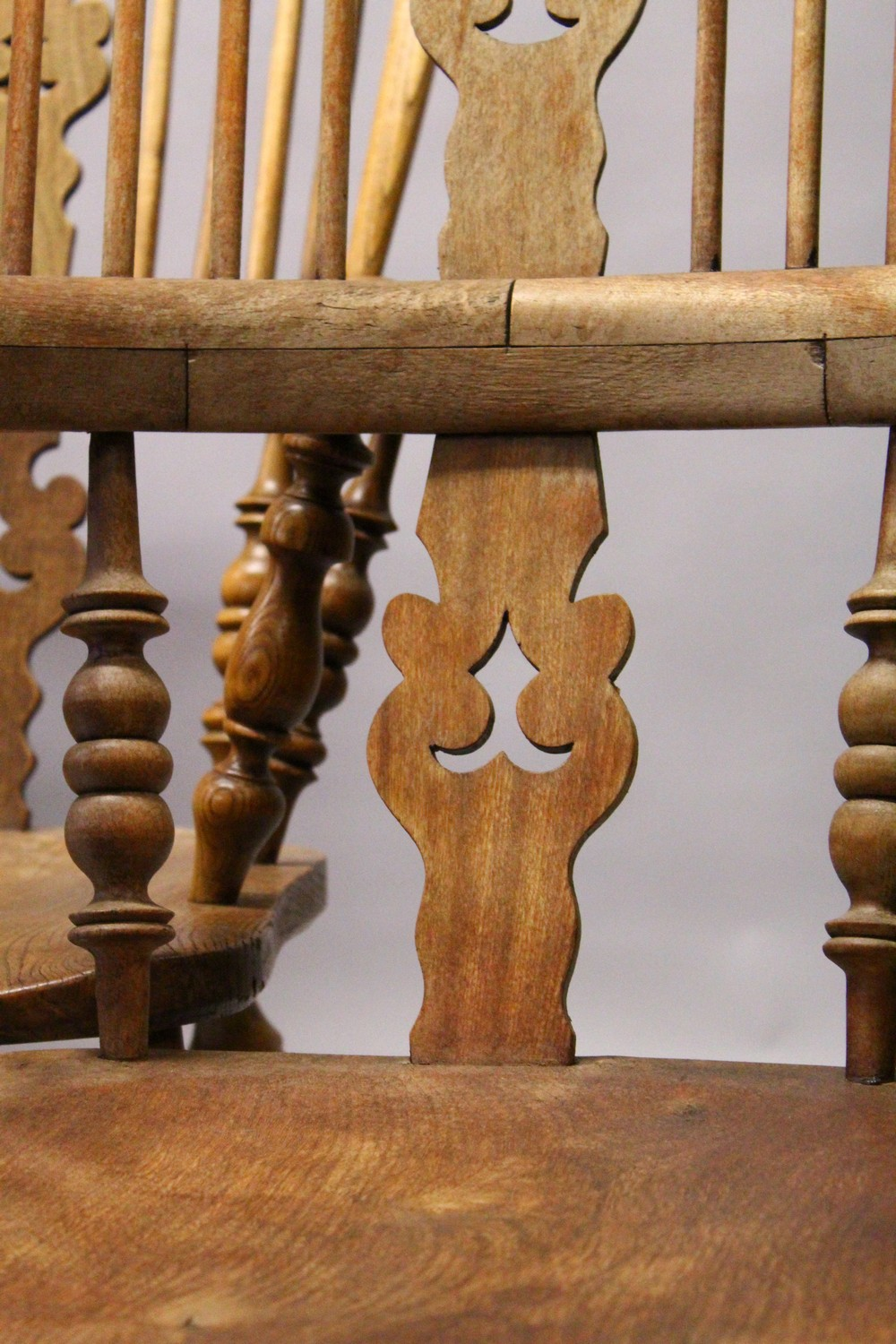Lot 1011 - A GOOD SET OF FOUR 19TH CENTURY OAK WINDSOR HIGH BACK ARMCHAIRS.