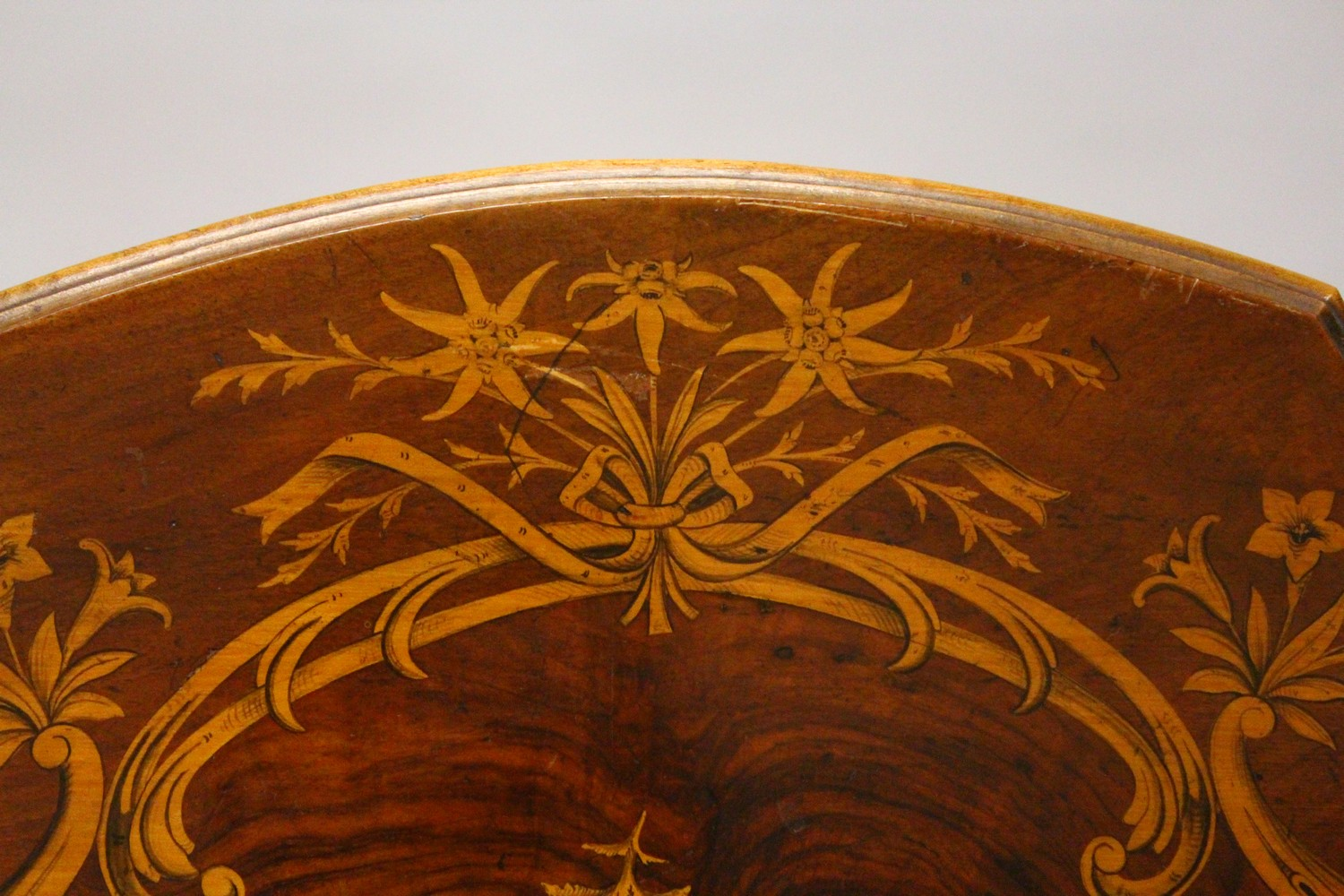Lot 1002 - A LATE 19TH CENTURY BLACK FOREST INLAID TABLE. 2ft 1.5ins wide x 2ft 7ins high.