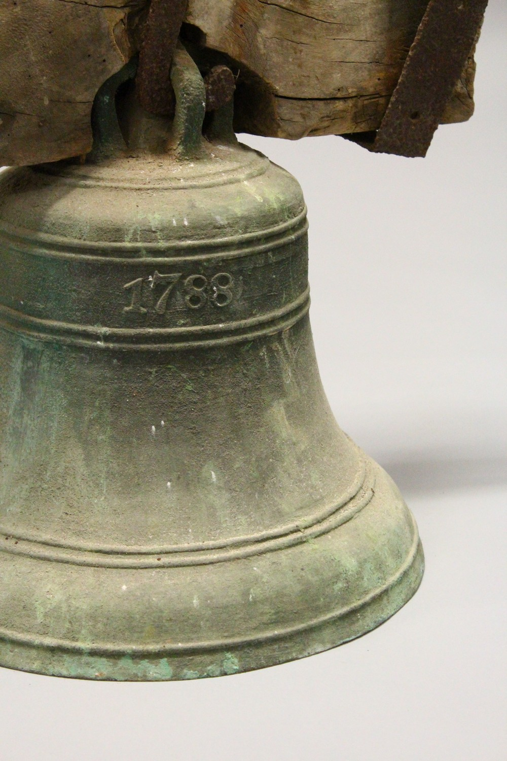Lot 1344 - A SIMILAR, SMALLER BELL, hung from a section of oak beam, with wrought iron mounts, bell lacking