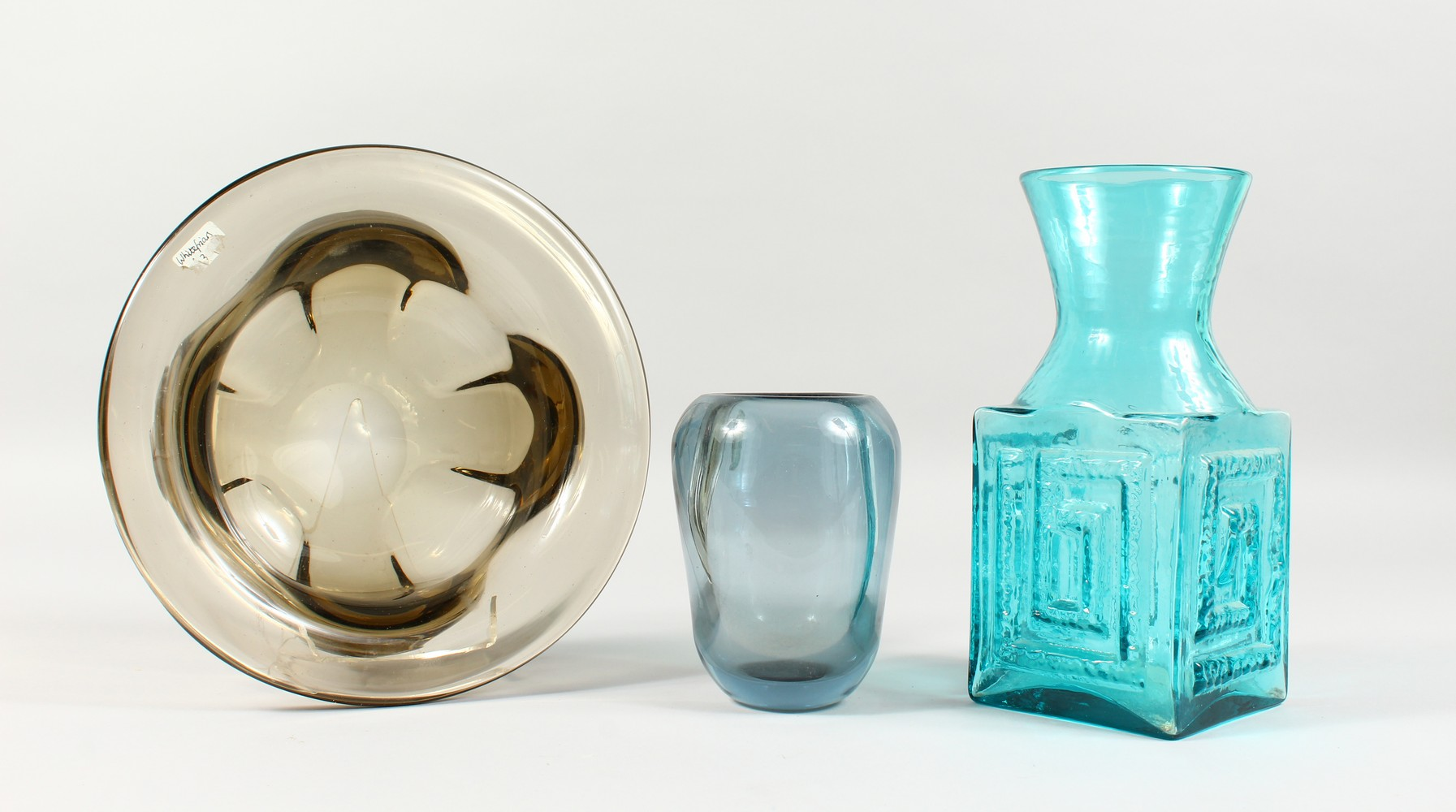 Lot 1060 - GEOFFREY BAXTER FOR WHITEFRIARS, a moulded turquoise glass vase, and two other items of