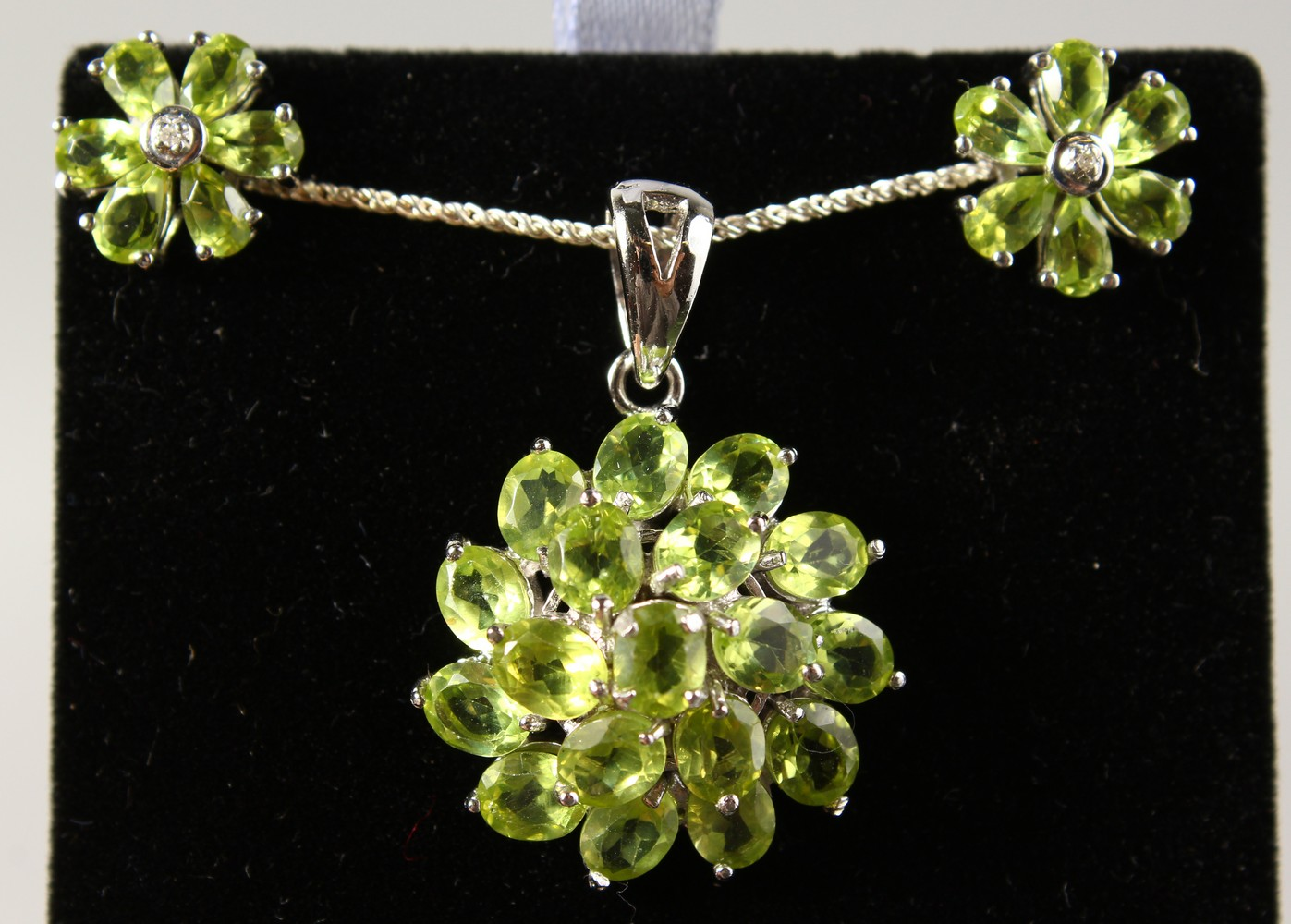Lot 1784 - A SILVER PERIDOT SET PENDANT, on chain, and EAR STUDS.