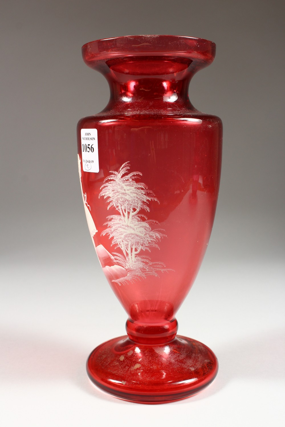 Lot 1056 - A MARY GREGORY CRANBERRY GLASS VASE, painted with a young girl in a landscape; together with a