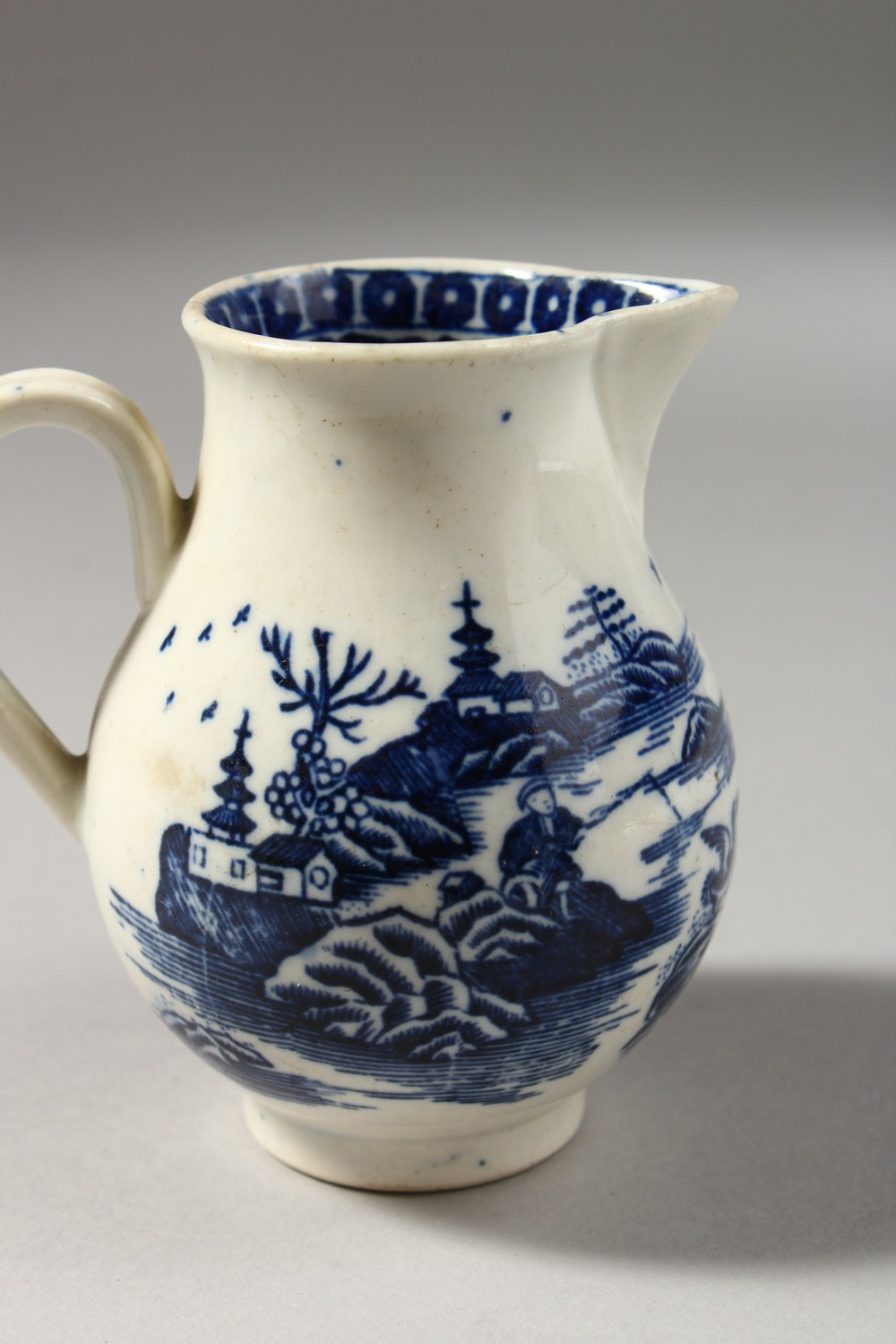 Lot 1073 - A CAUGHLEY BLUE AND WHITE SPARROW BEAK JUG, with two scenes, a man with a fish and a man fishing, no