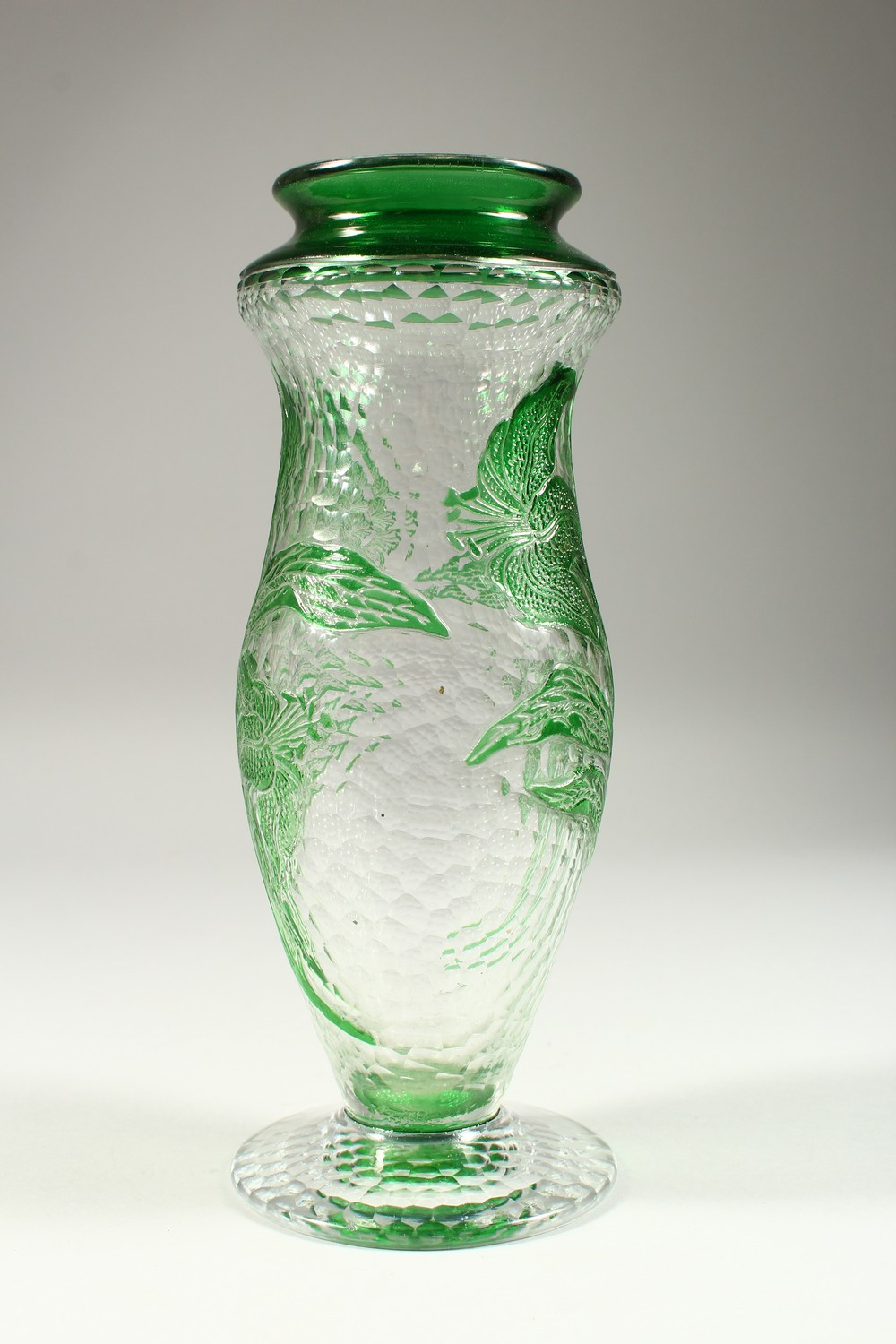 Lot 1042 - A FRENCH MOULDED AND CUT GLASS PEDESTAL VASE, with green floral decoration. 10.75ins high.
