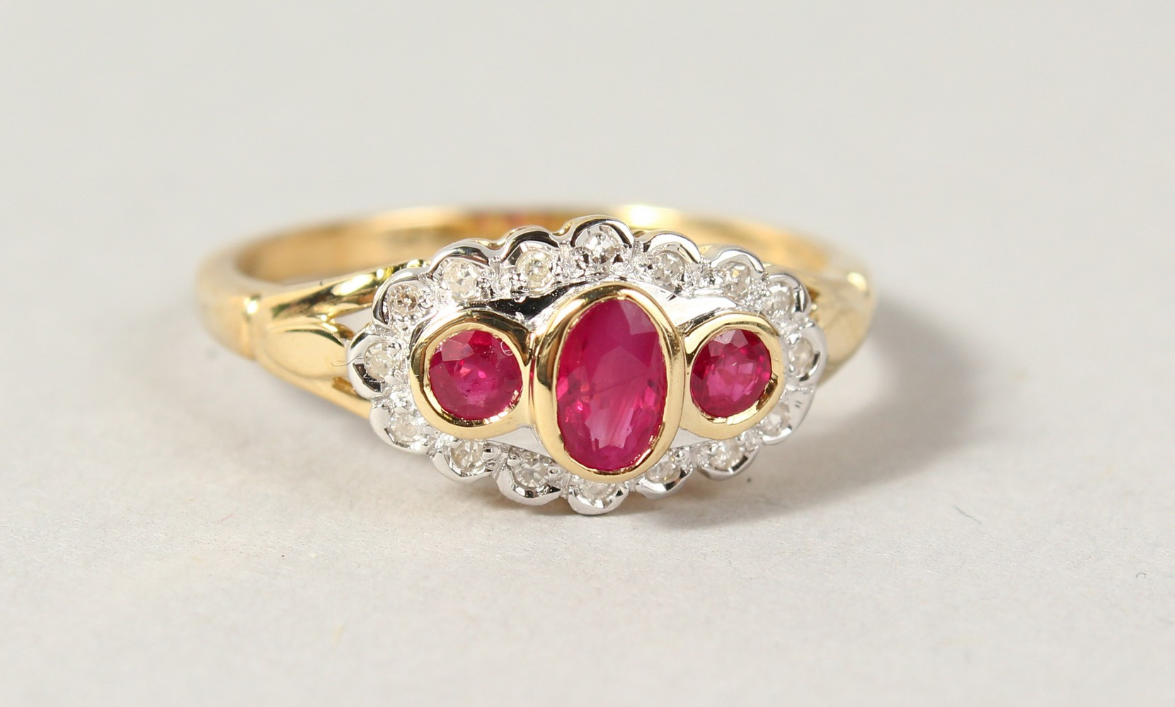 Lot 1767 - A 9CT GOLD, RUBY AND DIAMOND RING.