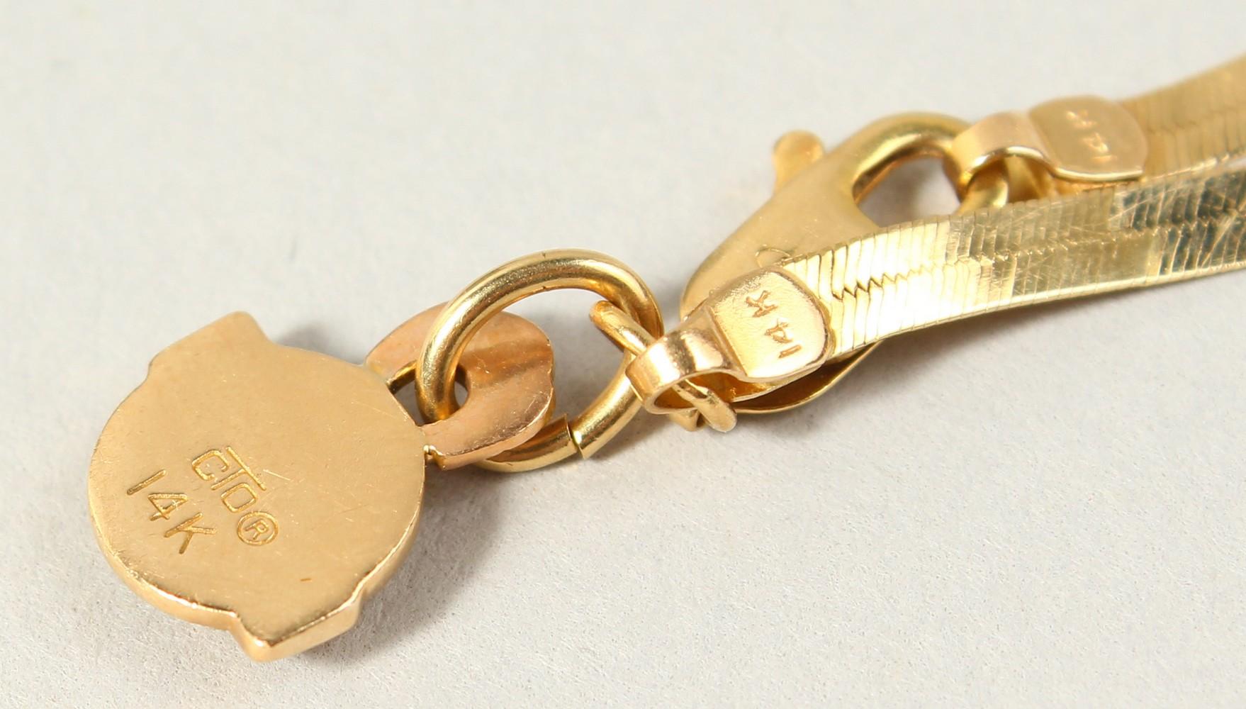 Lot 1742 - A 14K BECHTEL GOLD BRACELET, 2.9gms.
