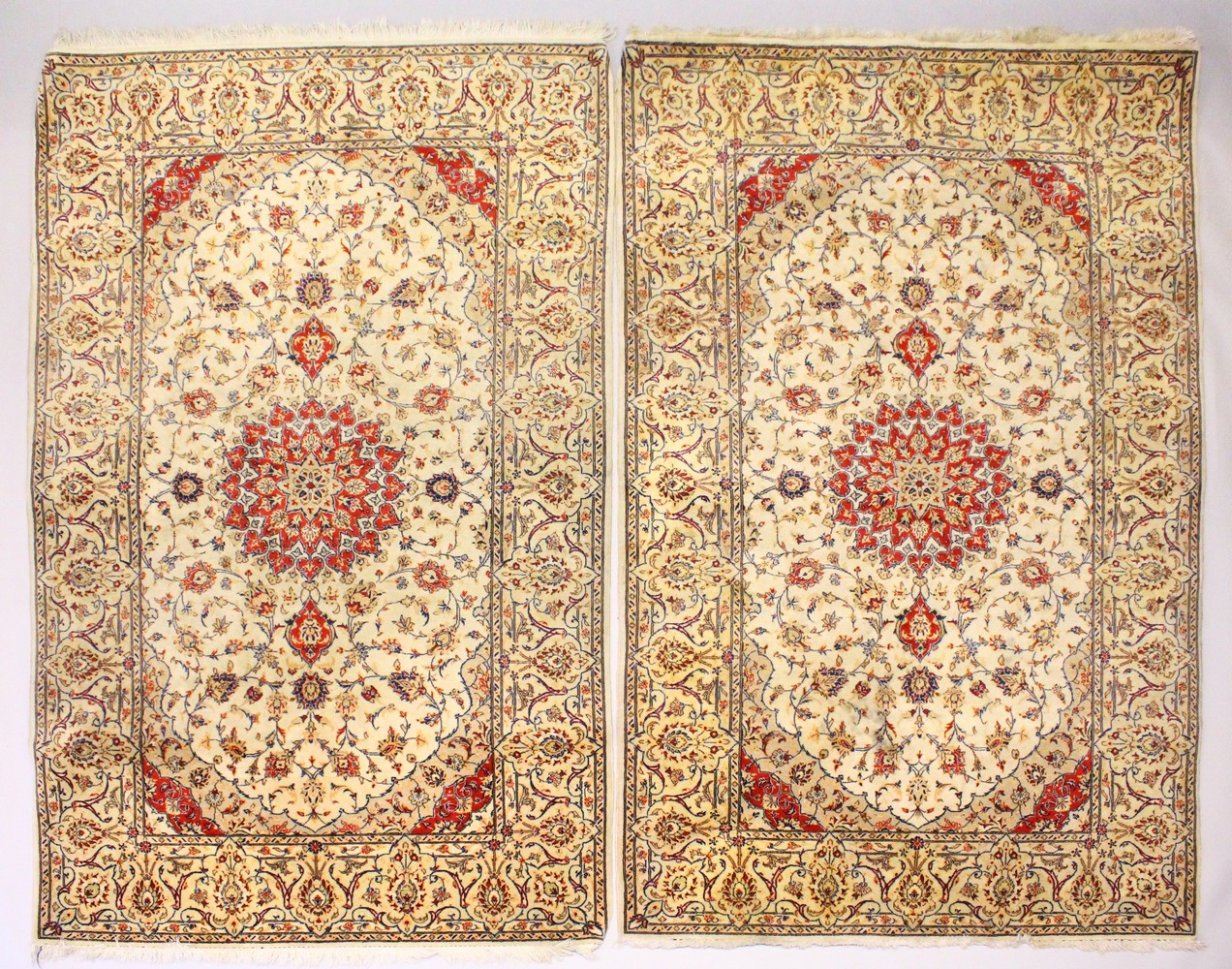 Lot 1033 - A PAIR OF PERSIAN TABRIZ CARPETS, beige ground with a central medallion and floral decoration (