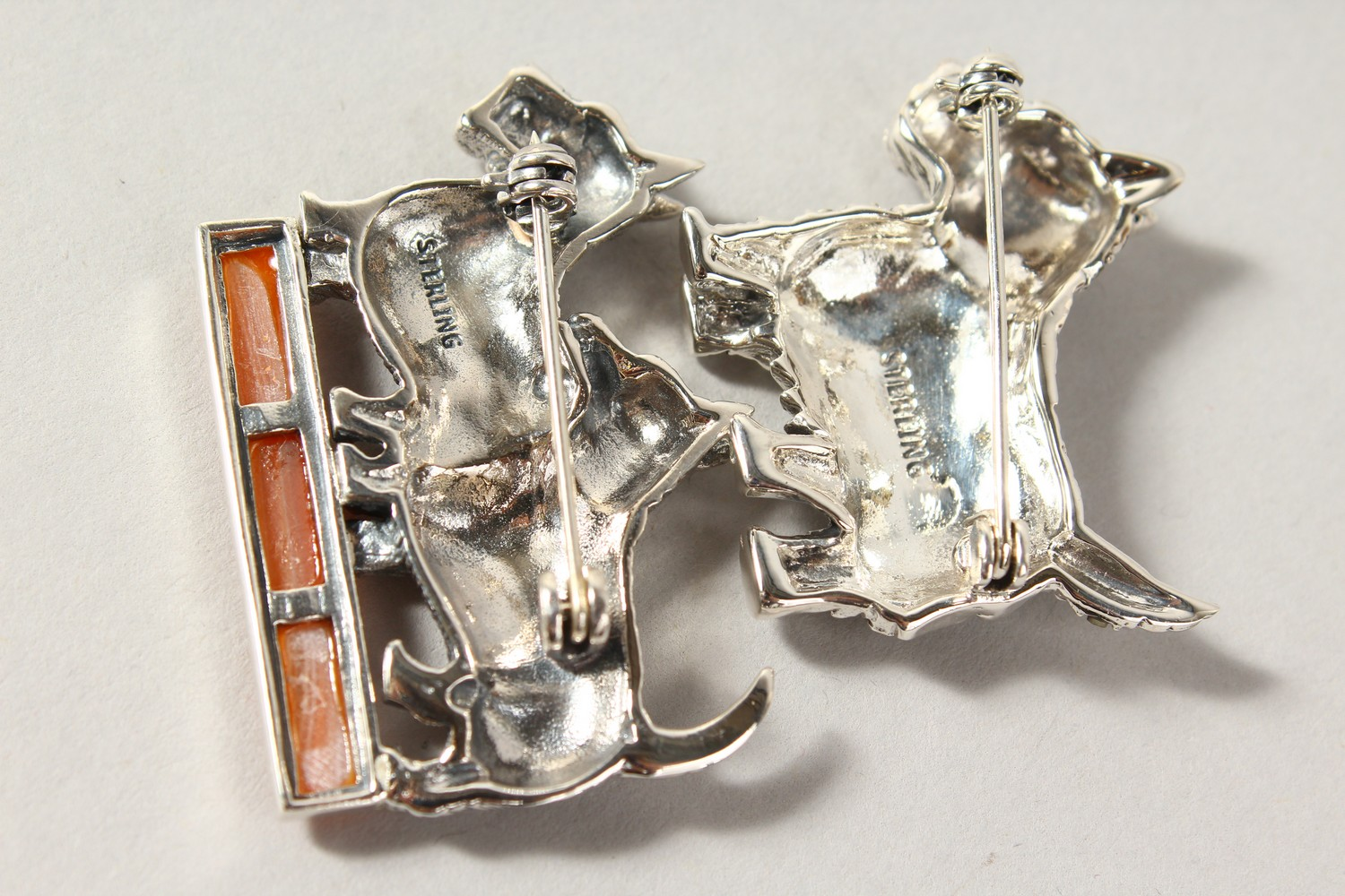 Lot 1642 - TWO NOVELTY SILVER SCOTTIE DOG BROOCHES.