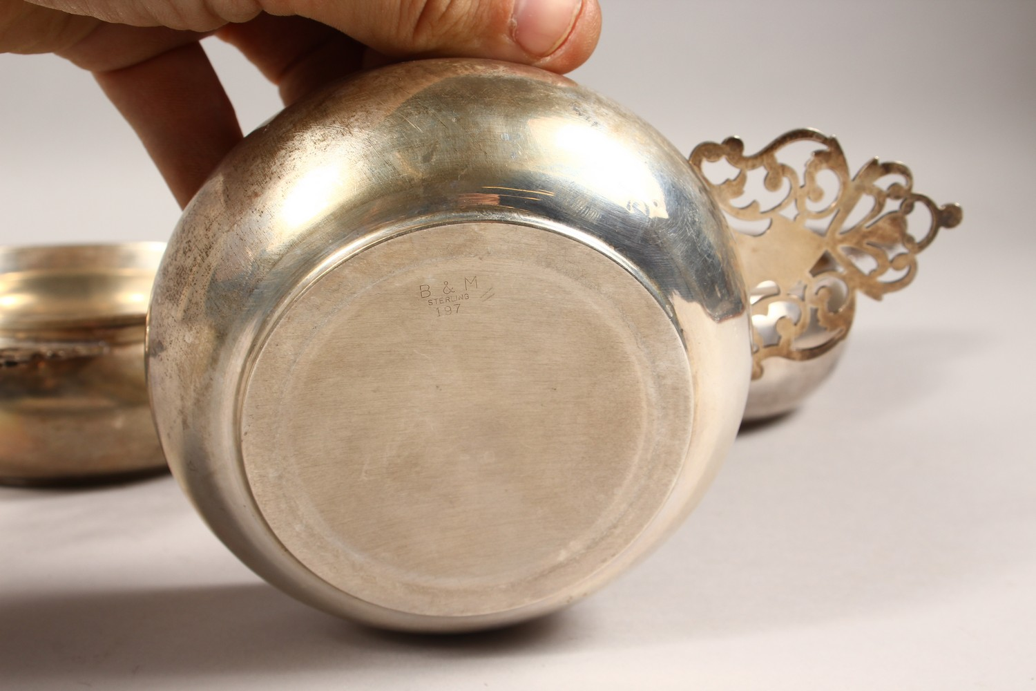 Lot 1881 - A STERLING SILVER PORRINGER, and two similar. 4.5ins diameter.
