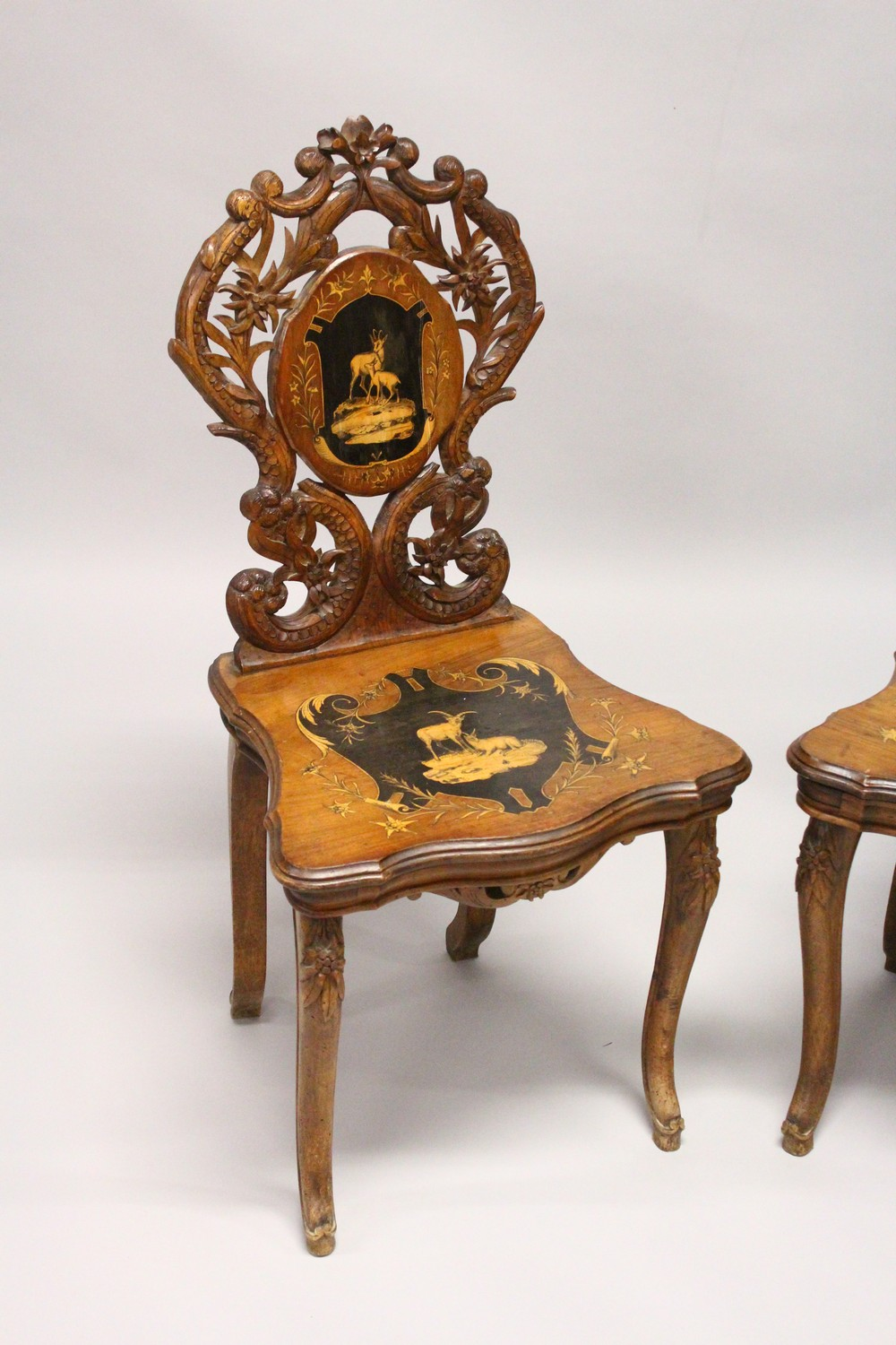 Lot 1003 - A PAIR OF LATE 19TH CENTURY BLACK FOREST INLAID MUSICAL SIDE CHAIRS, with inlaid backs and seats.