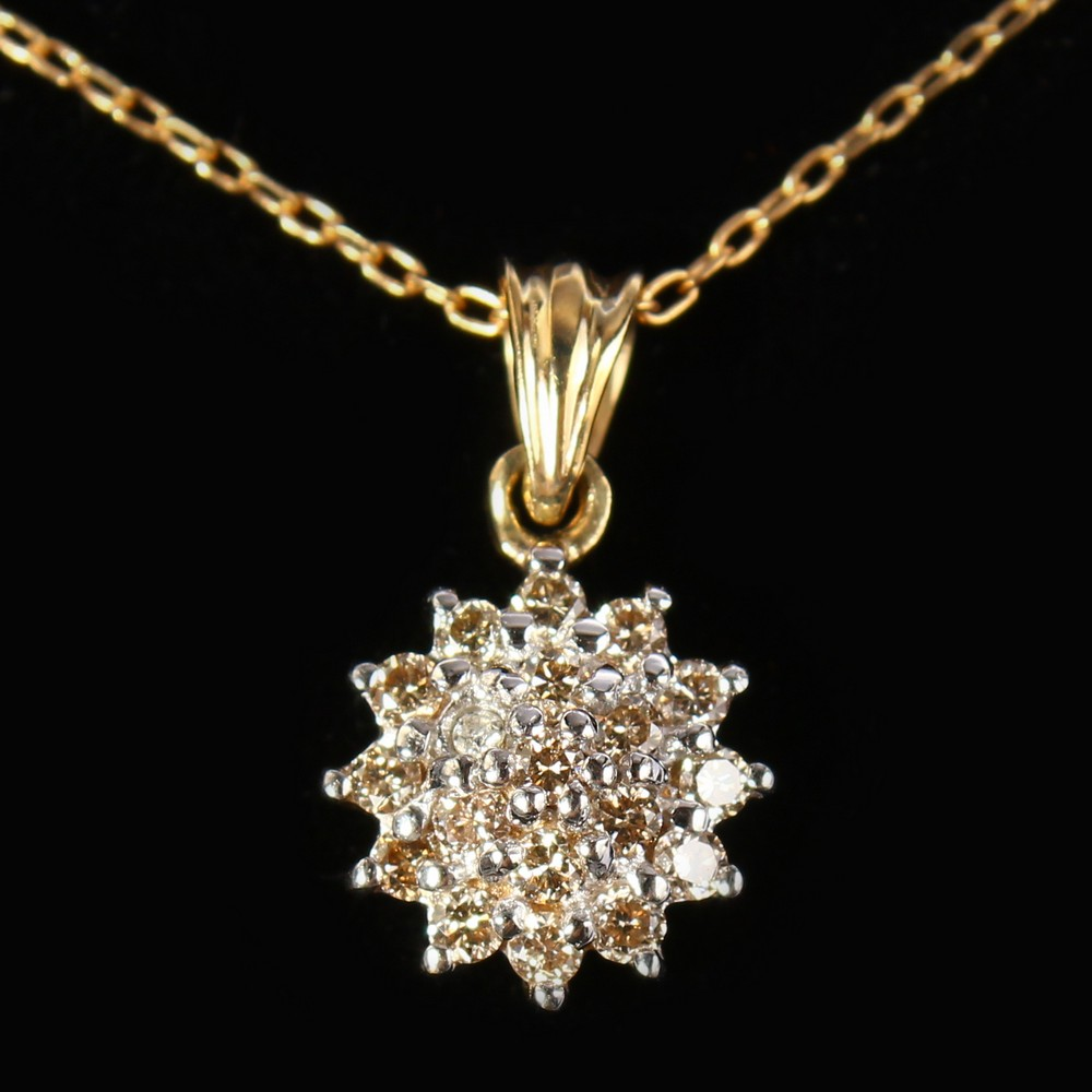 Lot 1756 - A 9CT GOLD DIAMOND CLUSTER PENDANT ON A CHAIN.