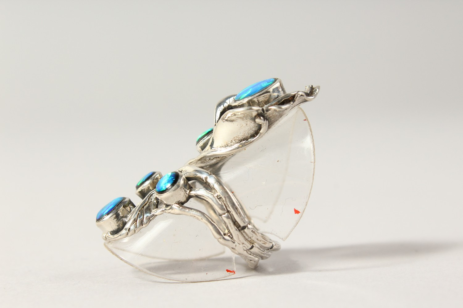 Lot 1775 - A SILVER REAL OPAL DECO STYLE RING.